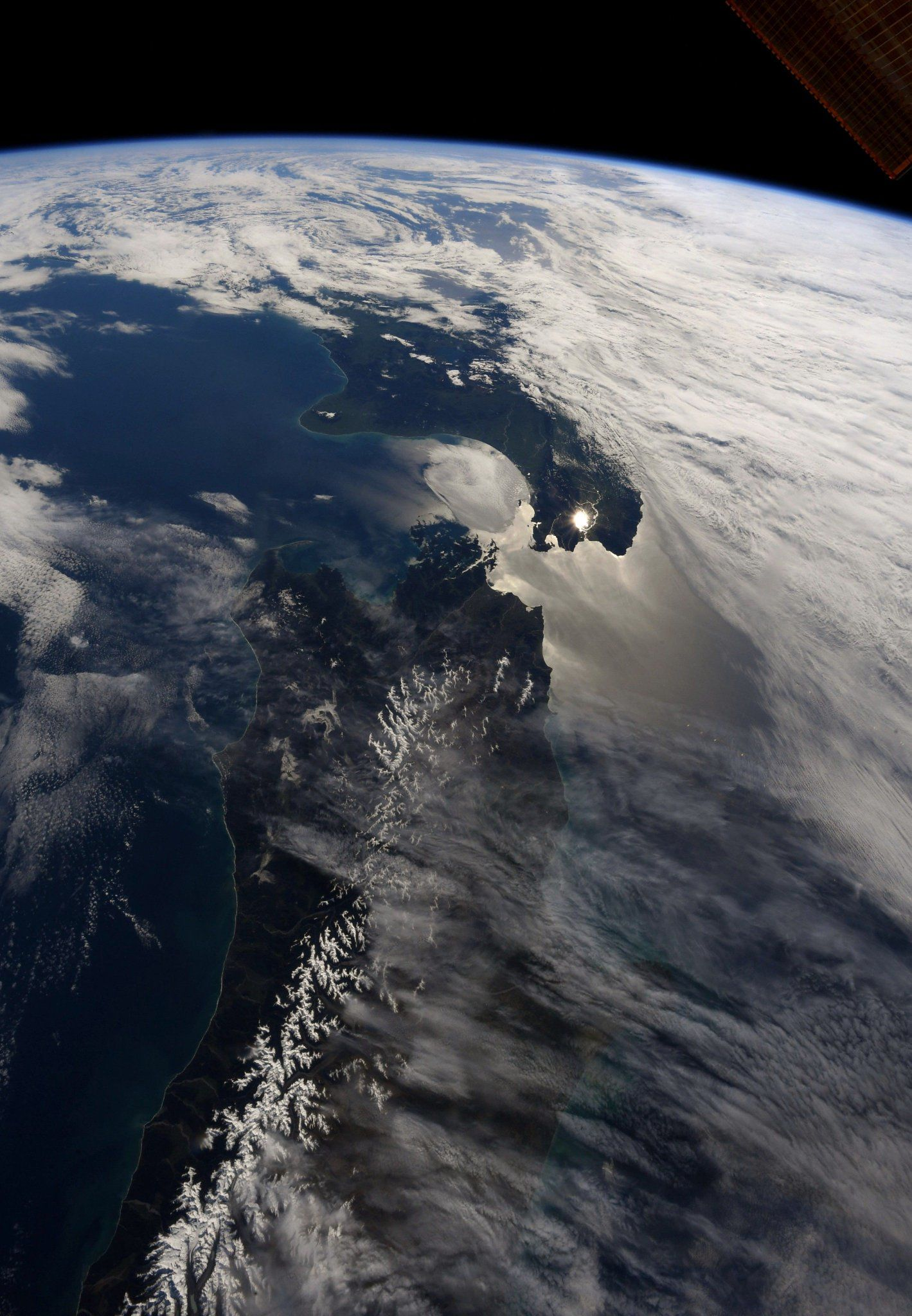 The early morning sun illuminates Cook Strait between the North and South Islands of #NewZealand (Photo & Caption Ricky Arnold, NASA)
