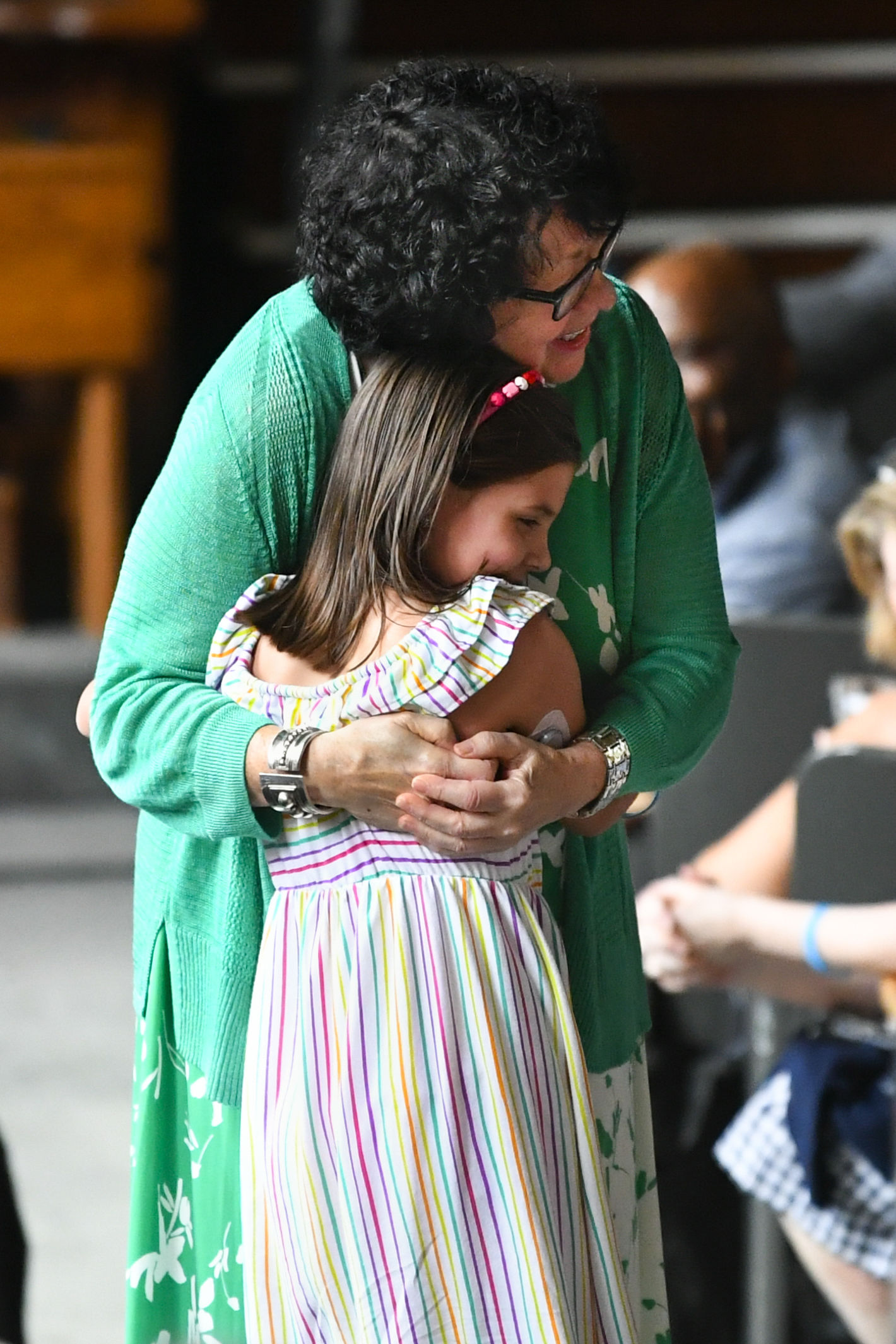 "U.S. Supreme Court Justice Sonia Sotomayor hugs a child who is a fellow diabetic during an event promoting her new children's book ""Just Ask!"" about children with ""life challenges"" including diabetes, held Sunday, Sept. 1, 2019, in Decatur, Ga. (AP Photo/John Amis)"