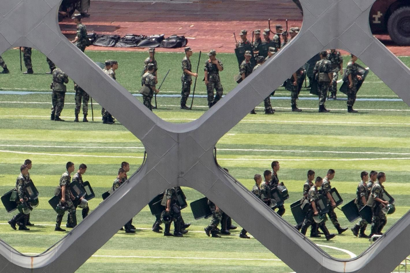 Chinese paramilitary policemen go through drills at the Shenzhen Bay Stadium in Shenzhen in Southern China's Guangdong province, Sunday, Aug. 18, 2019.{ } (AP Photo/Ng Han Guan)