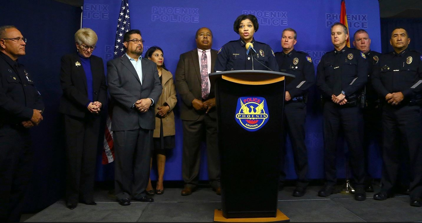 Joined by other police officials and city leaders, Phoenix Police Chief Jeri Williams, center, announces the arrest of Nathan Sutherland, a licensed practical nurse, on one count of sexual assault and one count of vulnerable adult abuse on an incapacitated woman who gave birth last month at a long-term health care facility Wednesday, Jan. 23. (AP Photo/Ross D. Franklin)
