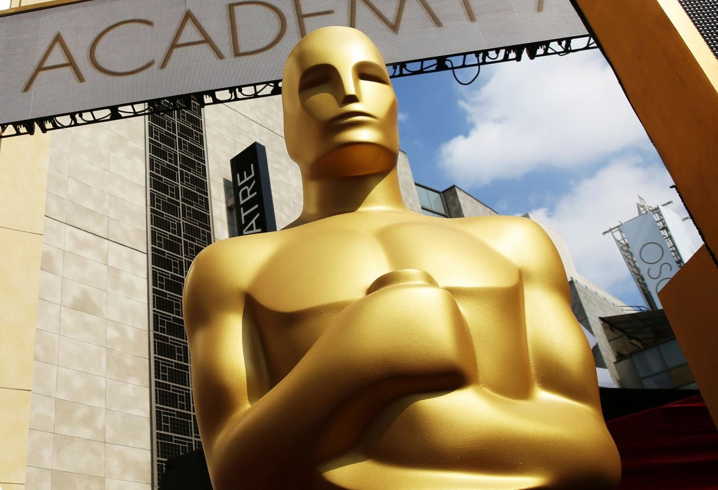 FILE - In this Feb. 21, 2015 file photo, an Oscar statue appears outside the Dolby Theatre for the 87th Academy Awards in Los Angeles.{ } (Photo by Matt Sayles/Invision/AP, File)