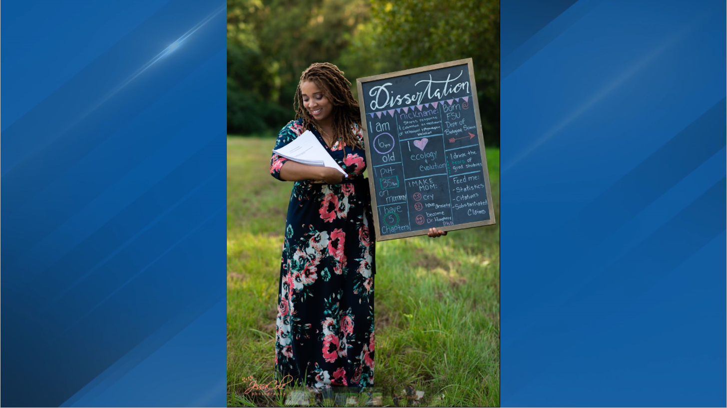 Woman poses with dissertation in hilarious maternity photo shoot (Korie Mitchell JessaCole Photography)