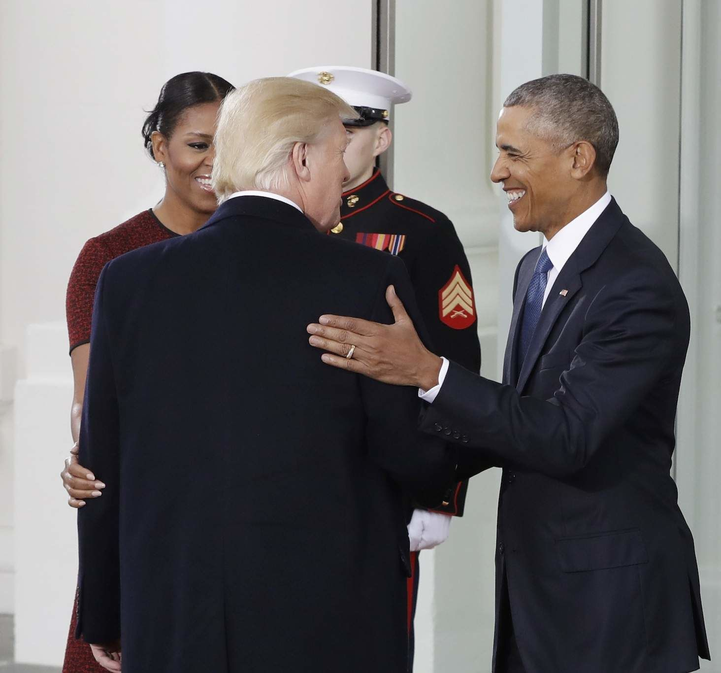 President Barack Obama and first lady Michelle Obama greet President-elect Donald Trump at the White House in Washington, Friday, Jan. 20, 2017. (AP Photo/Evan Vucci)
