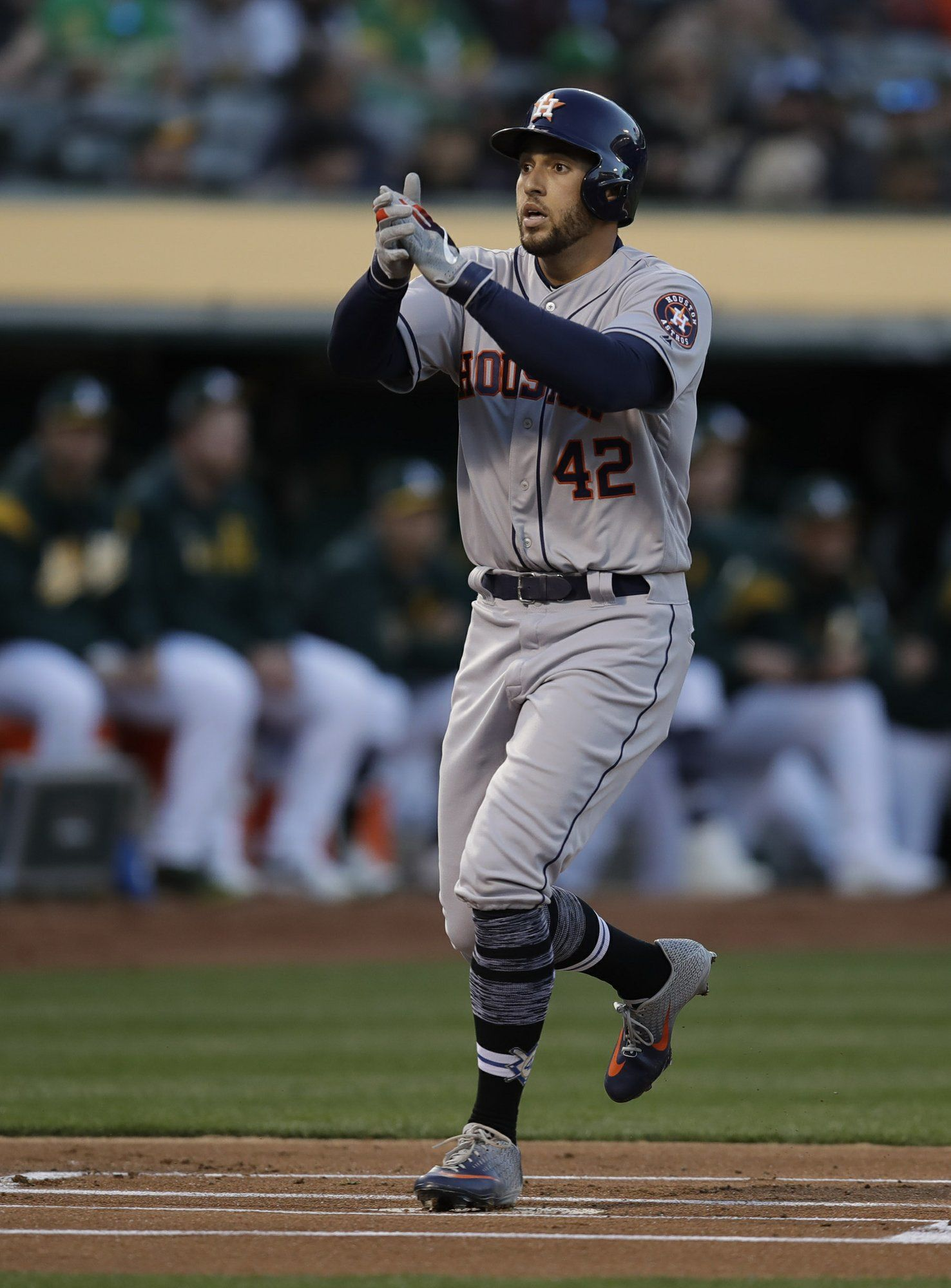 Houston Astros' George Springer celebrates after hitting a home run off Oakland Athletics' Marco Estrada in the first inning of a baseball game, Tuesday, April 16, 2019, in Oakland, Calif. (AP Photo/Ben Margot)