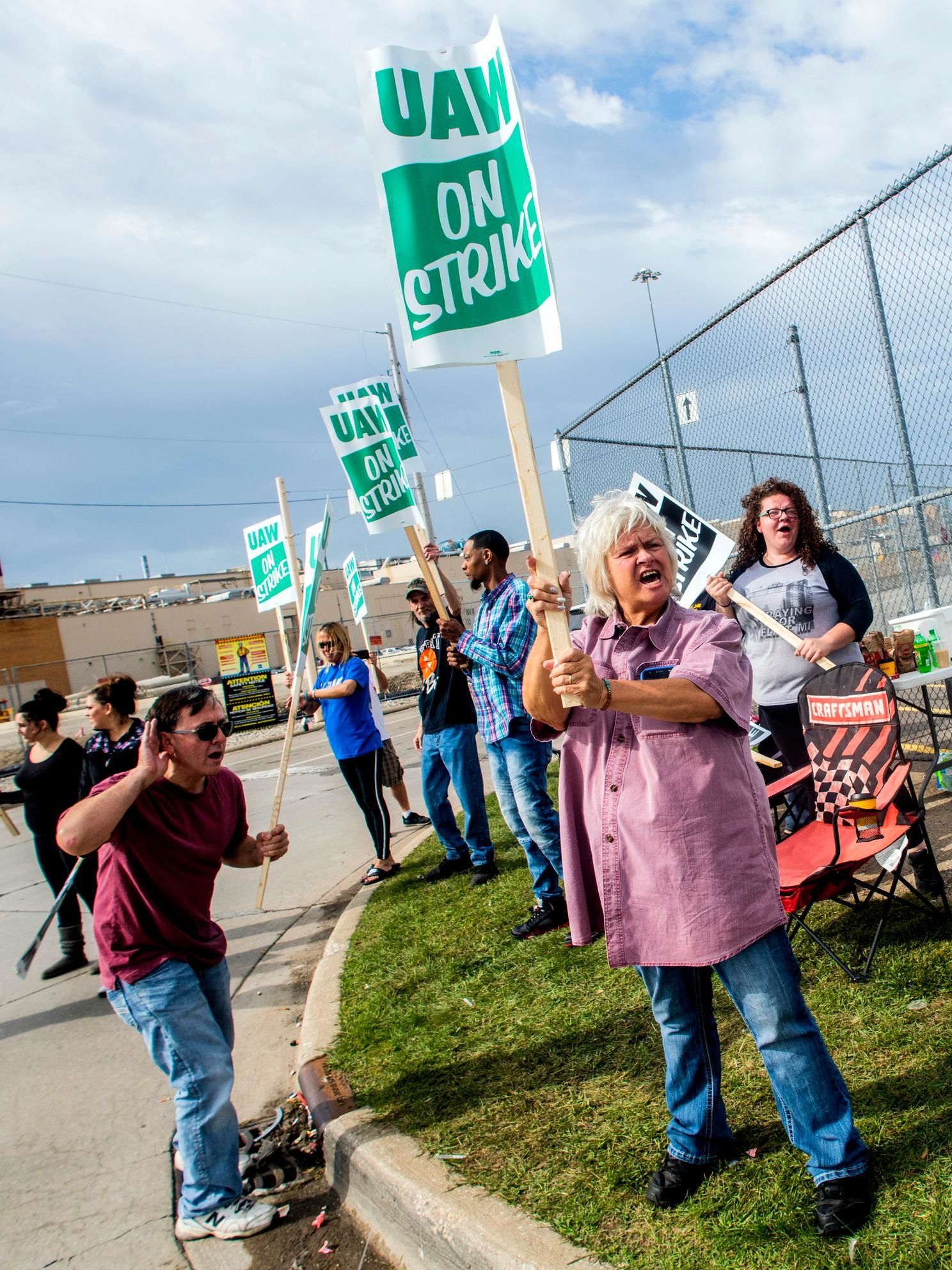 Susan Donovan, of Davison, stands outside of the Flint Assembly Plant as General Motors employees demonstrate on Sunday, Sept. 15, 2019, in Flint, Mich. The United Auto Workers union says its contract negotiations with GM have broken down and its members will go on strike just before midnight on Sunday.  (Jake May/The Flint Journal via AP)