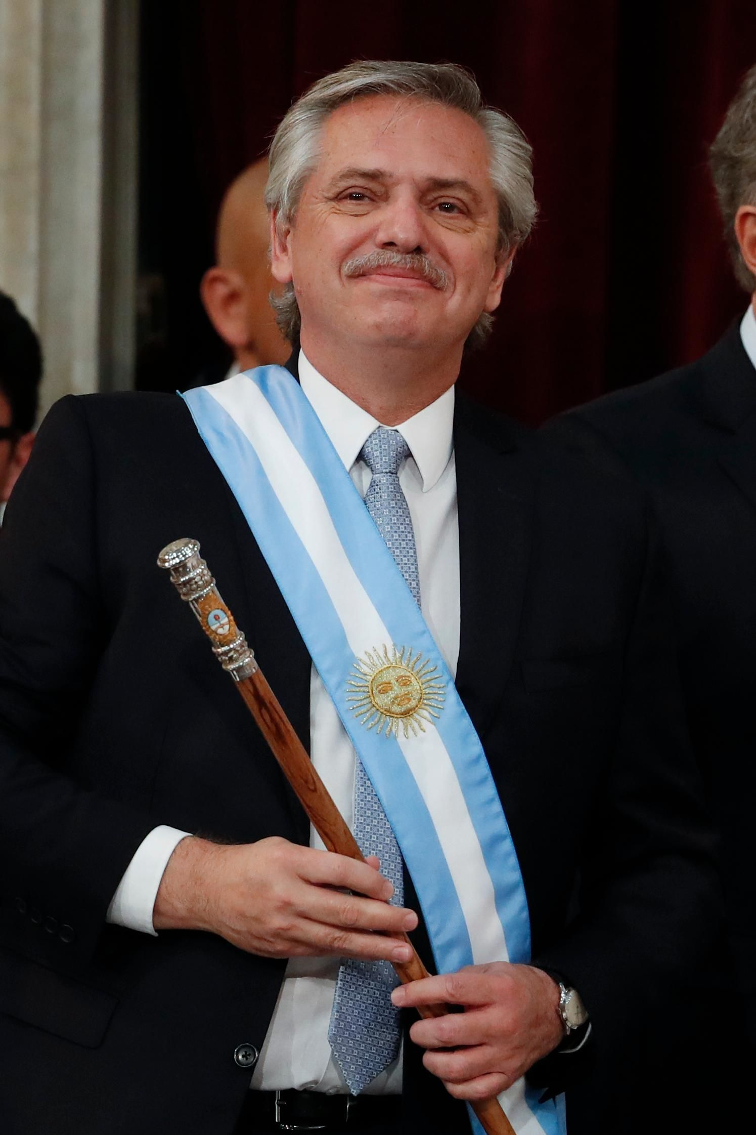 Argentina's new President Alberto Fernandez smiles after taking the oath of office at the Congress in Buenos Aires, Argentina, Tuesday, Dec. 10, 2019. (AP Photo/Natacha Pisarenko)