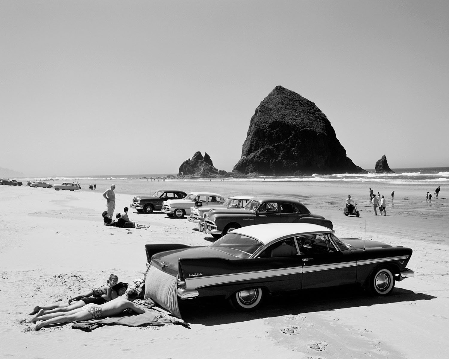 Cars on Cannon Beach on the Oregon Coast. (Photo by Ray Atkeson/Used with permission University of Oregon Libraries)
