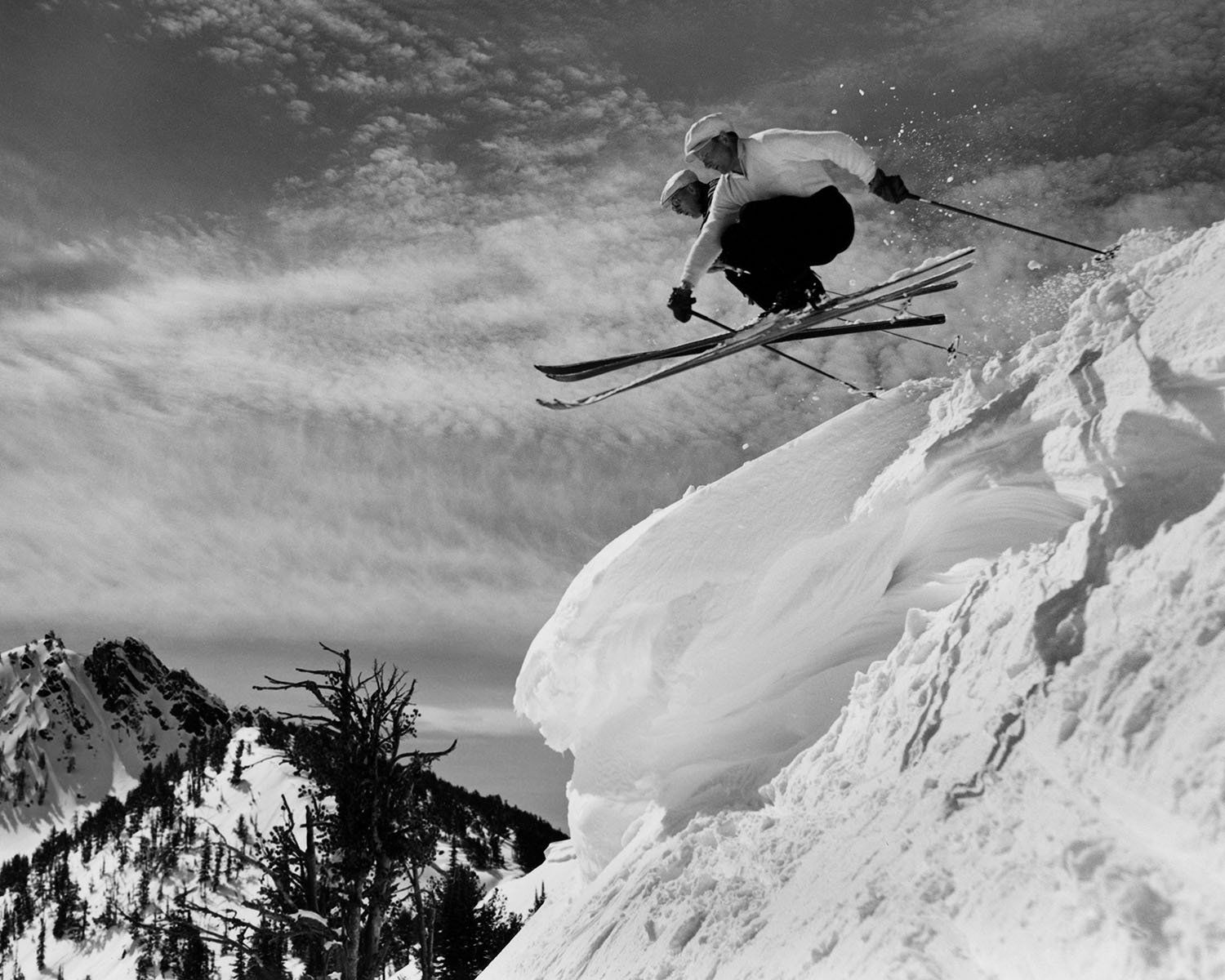 Two skiers jump off a cornice at Anthony Lakes Ski Area in northeastern Oregon.{ }(Photo by Ray Atkeson/Used with permission University of Oregon Libraries)
