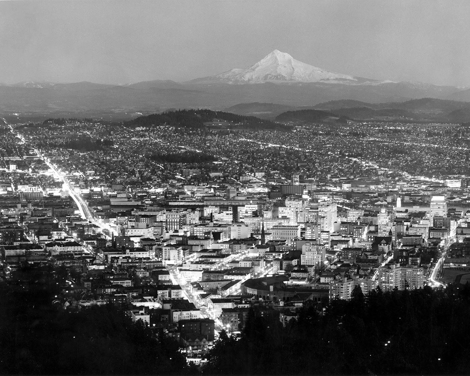 Mount Hood and Portland at twilight.{ }(Photo by Ray Atkeson/Used with permission University of Oregon Libraries)