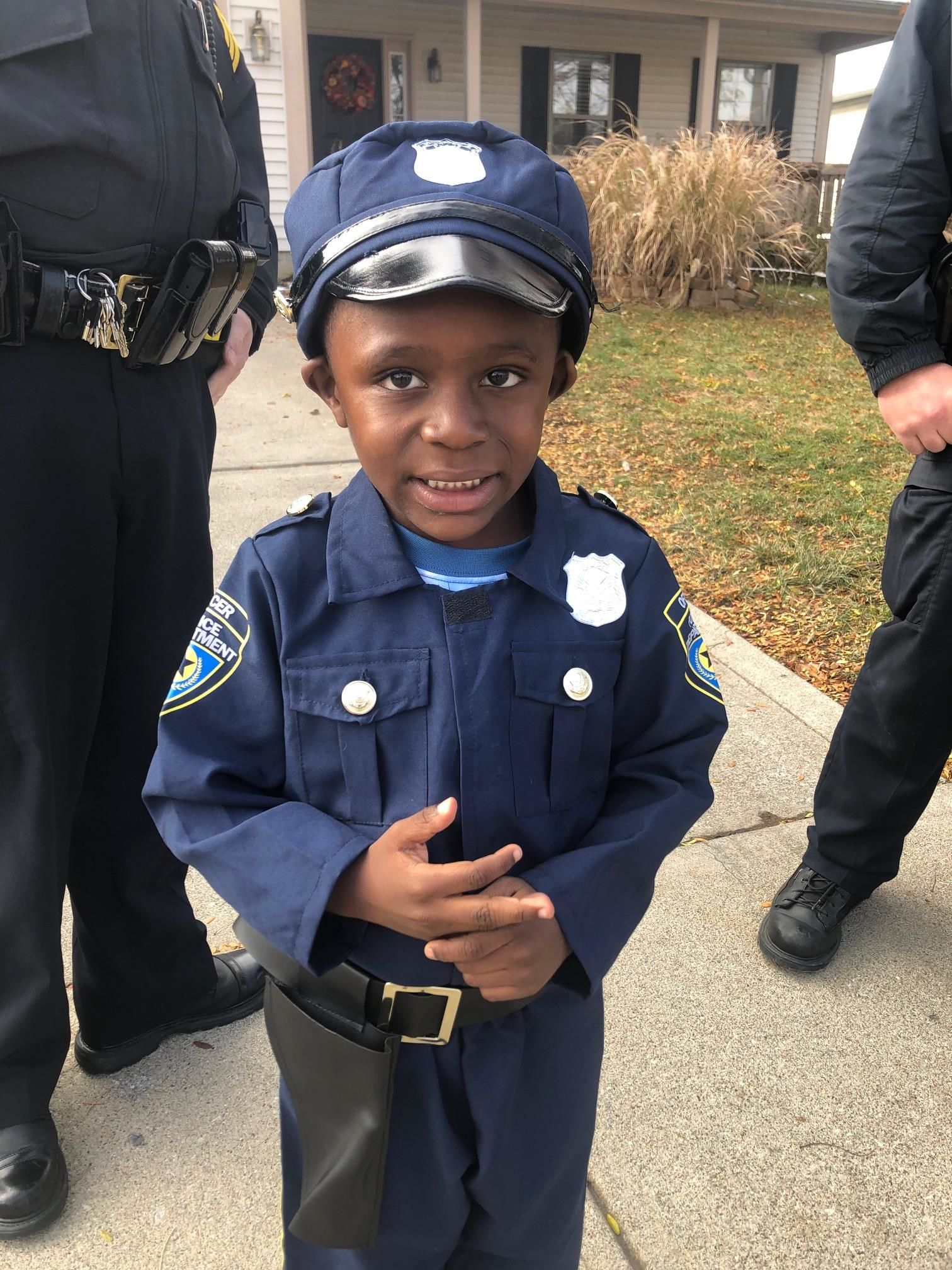 "Four-year-old Tyrone met with Columbus Police officers Thursday Nov. 14, 2019 after winning the annual ""Cute Cop Costume Contest."" (WSYX/WTTE)"