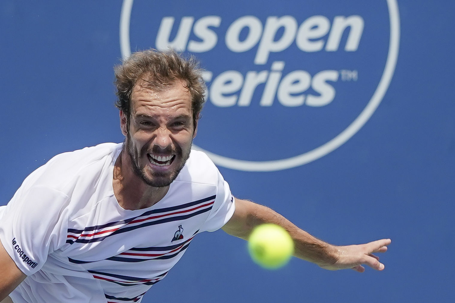Richard Gasquet, of France, serves to Roberto Bautista Agut, of Spain, during the Western & Southern Open tennis tournament, Friday, Aug. 16, 2019, in Mason, Ohio. (AP Photo/John Minchillo)