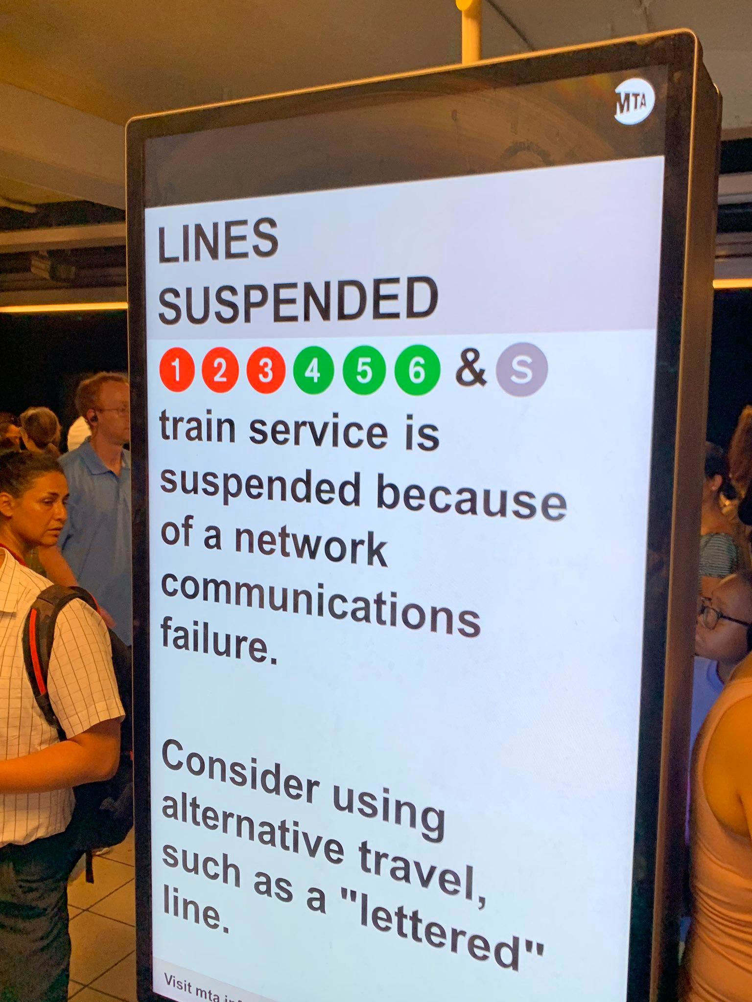 In this photo provided by Kenneth Ferrone, a digital sign on a New York City subway platform warns commuters of a service disruption on several lines, Friday, July 19, 2019, in New York. (Kenneth Ferrone via AP)