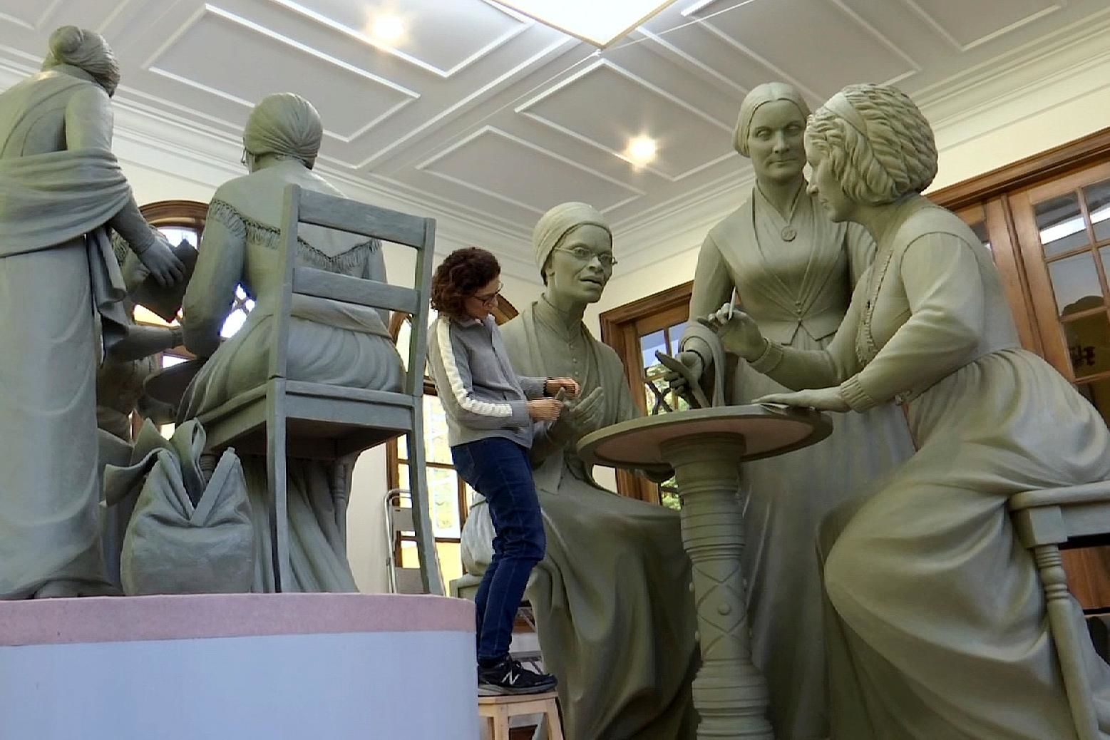 In this Nov. 4, 2019, still image from video, sculptor Meredith Bergmann works on the first women's statue that will be installed in New York's Central Park, in her studio in Ridgefield, Conn.{ } (AP Photo/Joseph Frederick)