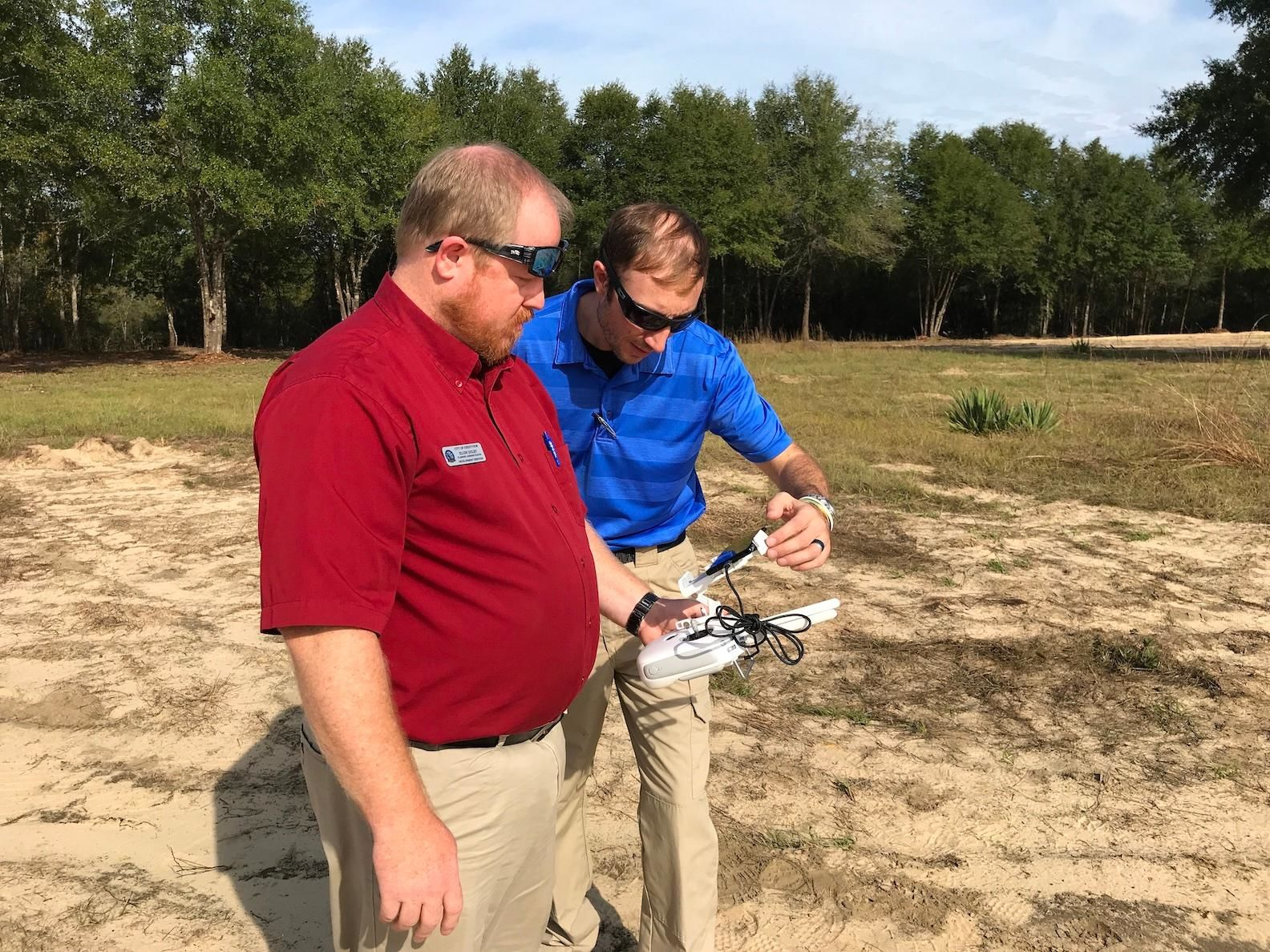 Drone instructor Mario Werth assists student pilot Trae Duly, a Crestview firefighter and Development Services planning administrator, calibrate his control panel before he launched his drone. (Photo: Brian Hughes, Public Information Officer, City of Crestview)