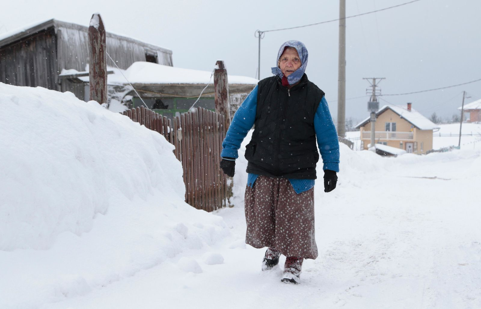 A Bosnian woman walks on a snow covered road in a remote village near Kladanj, 80 kms north of Sarajevo, Bosnia, Friday, Jan. 11. .(AP Photo/Amel Emric)