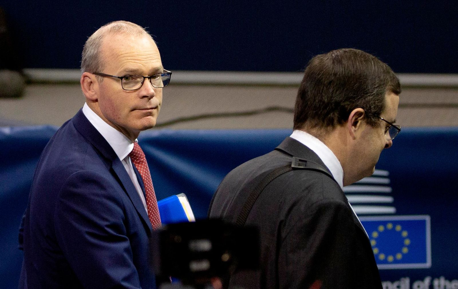 Irish Foreign Minister Simon Coveney, left, arrives for a meeting of EU foreign ministers at the European Convention Center in Luxembourg, Monday, Oct. 14, 2019.{ } (AP Photo/Virginia Mayo)