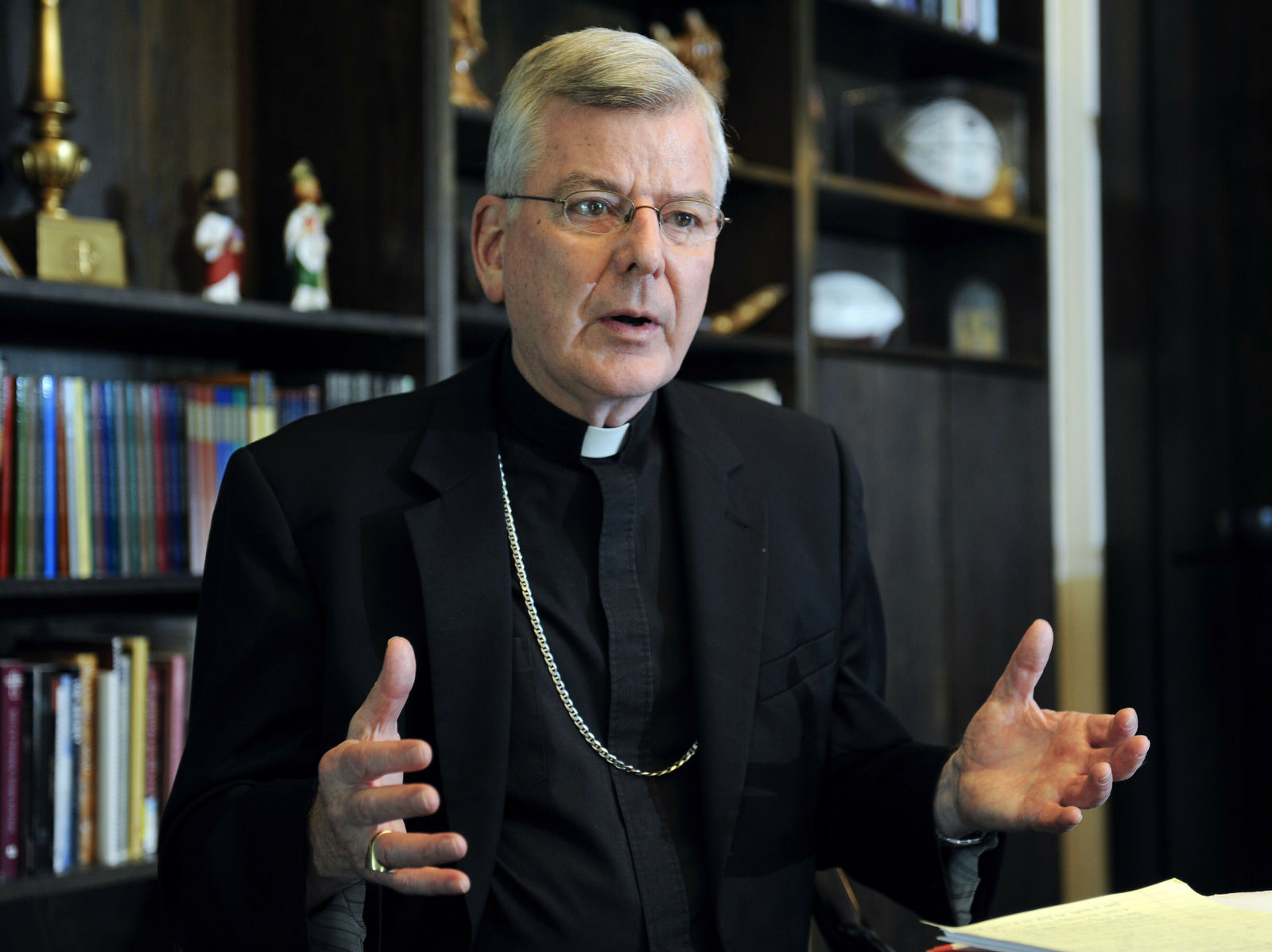 FILE - In this July 30, 2014, file photo, St. Paul-Minneapolis Archbishop John Nienstedt speaks at his office in St. Paul, Minn. (AP Photo/Craig Lassig, File)
