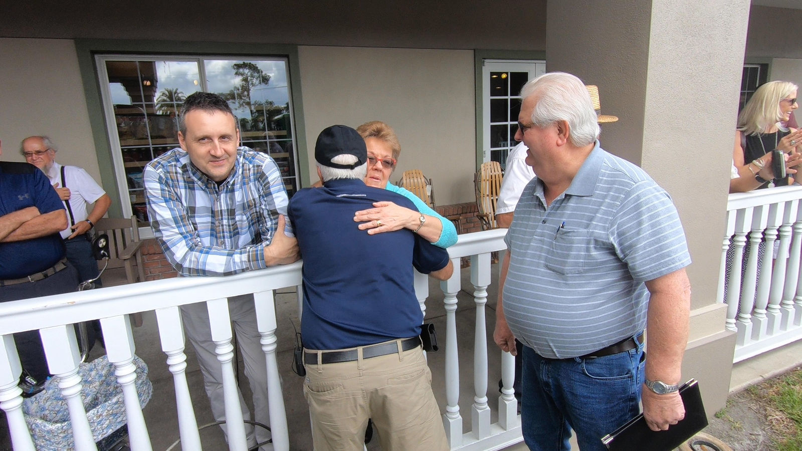 C. Ivan Stoltzfus receives hugs as he finishes his journey near Sarasota, Fla. (WPEC)