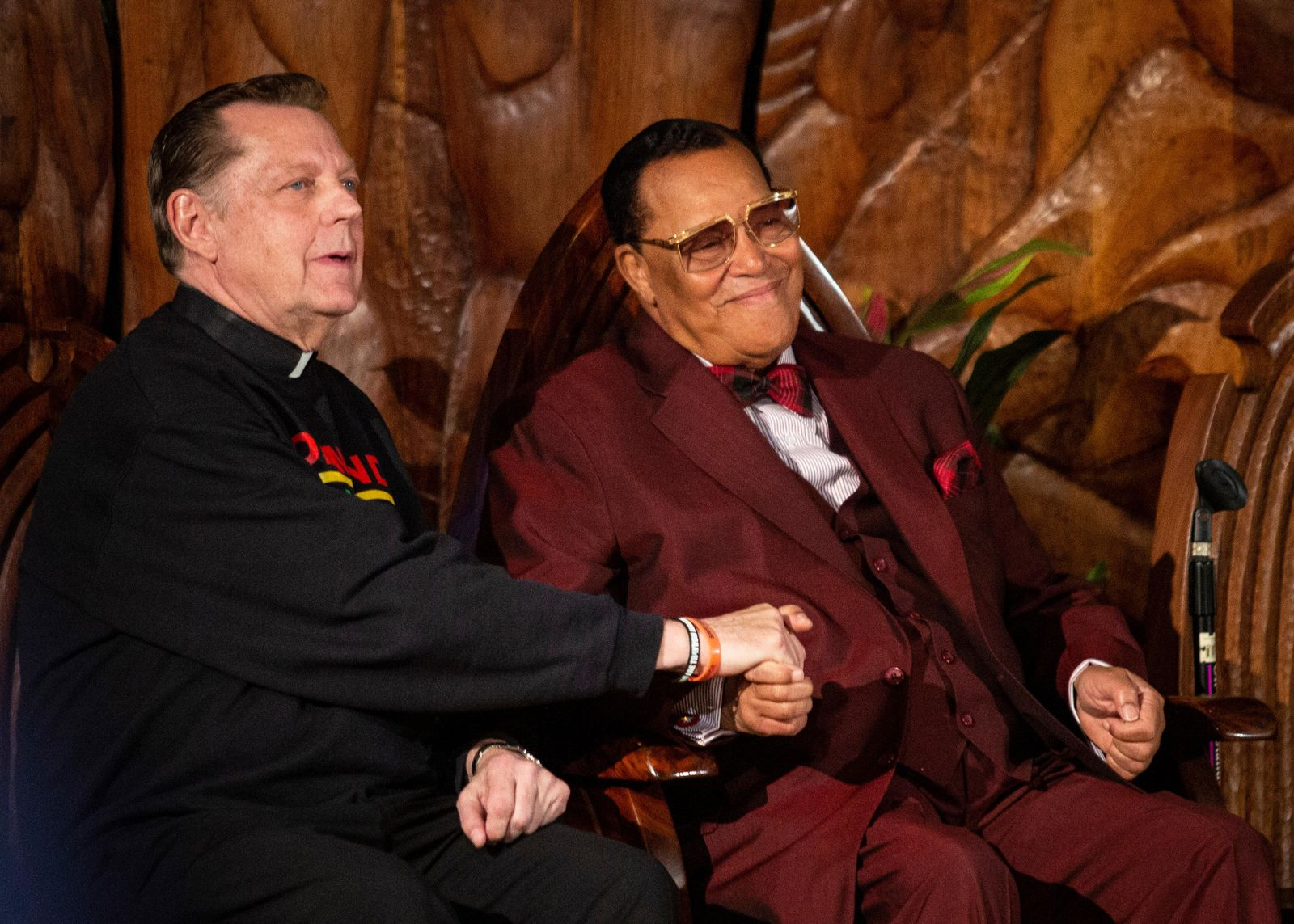 Father Michael Pfleger sits next to Minister Louis Farrakhan, of the Nation of Islam, before they both speak at Saint Sabina Church, Thursday night, May 9, 2019, in Chicago. (Ashlee Rezin/Chicago Sun-Times via AP)