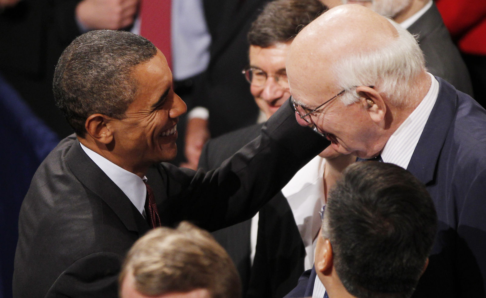 FILE - In this July 21, 2010, file photo President Barack Obama greets Paul Volcker, Chair of the President's Economic Recovery Advisory Board, after Obama signed the Dodd-Frank Wall Street Reform and Consumer Protection financial reform bill at the Ronald Reagan Building in Washington. Volcker, the former Federal Reserve chairman died on Sunday, Dec. 8, 2019, according to his office, He was 92.{ }(AP Photo/Charles Dharapak, File)