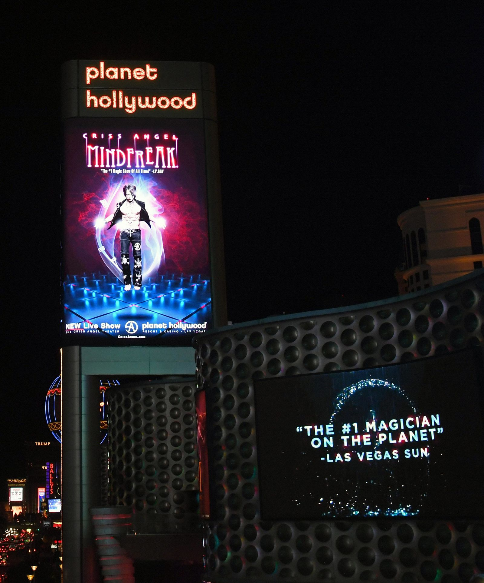 "LAS VEGAS, NEVADA - JANUARY 19:  The marquee and a sign at Planet Hollywood Resort & Casino show an advertisement for ""Criss Angel MINDFREAK"" during the show's grand opening on January 19, 2019 in Las Vegas, Nevada.  (Photo by Ethan Miller/Getty Images for Planet Hollywood Resort & Casino)"
