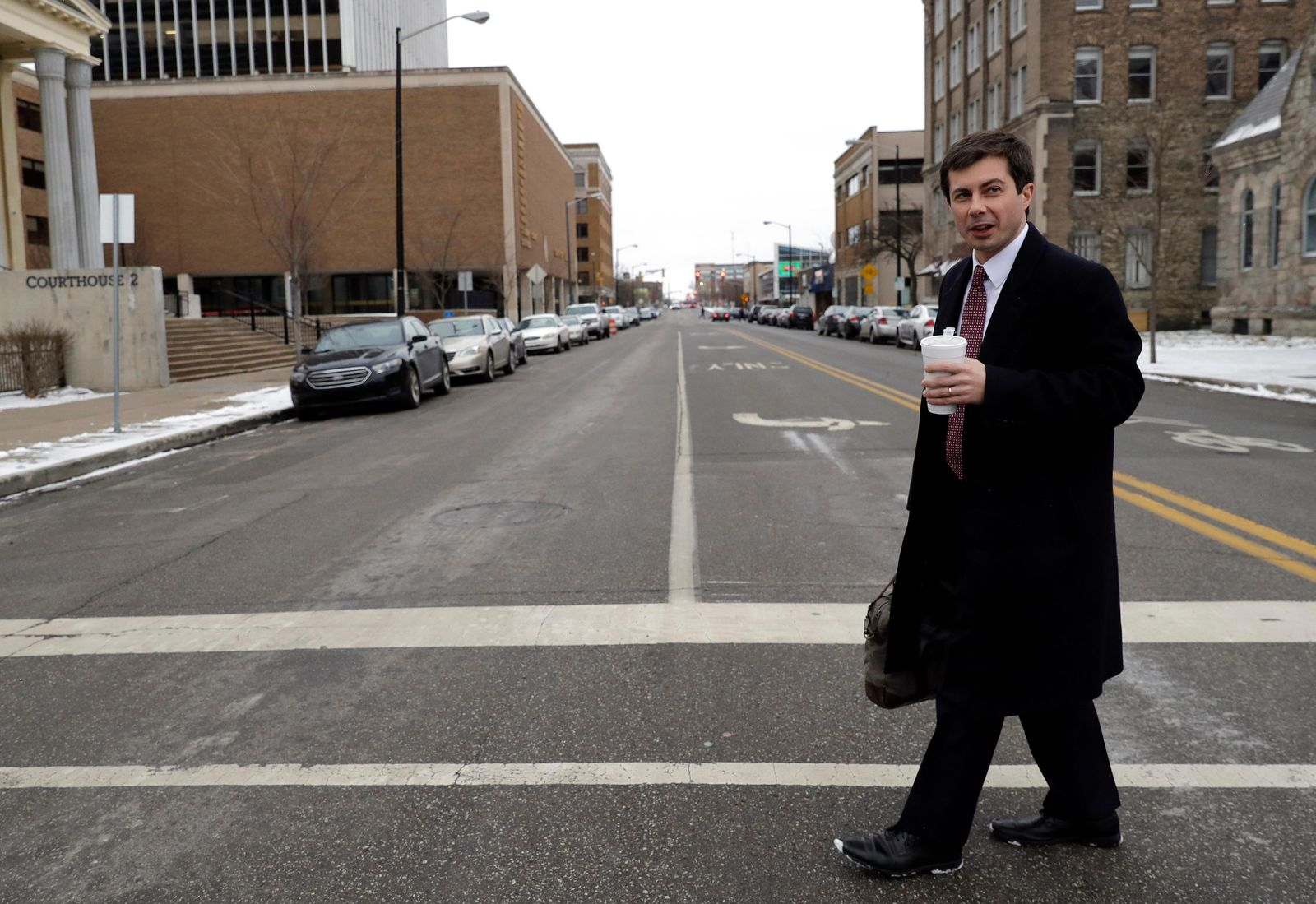Mayor Pete Buttigieg talks with an AP reporter as he walks in downtown South Bend, Ind., Thursday, Jan. 10, 2019.{ } (AP Photo/Nam Y. Huh)