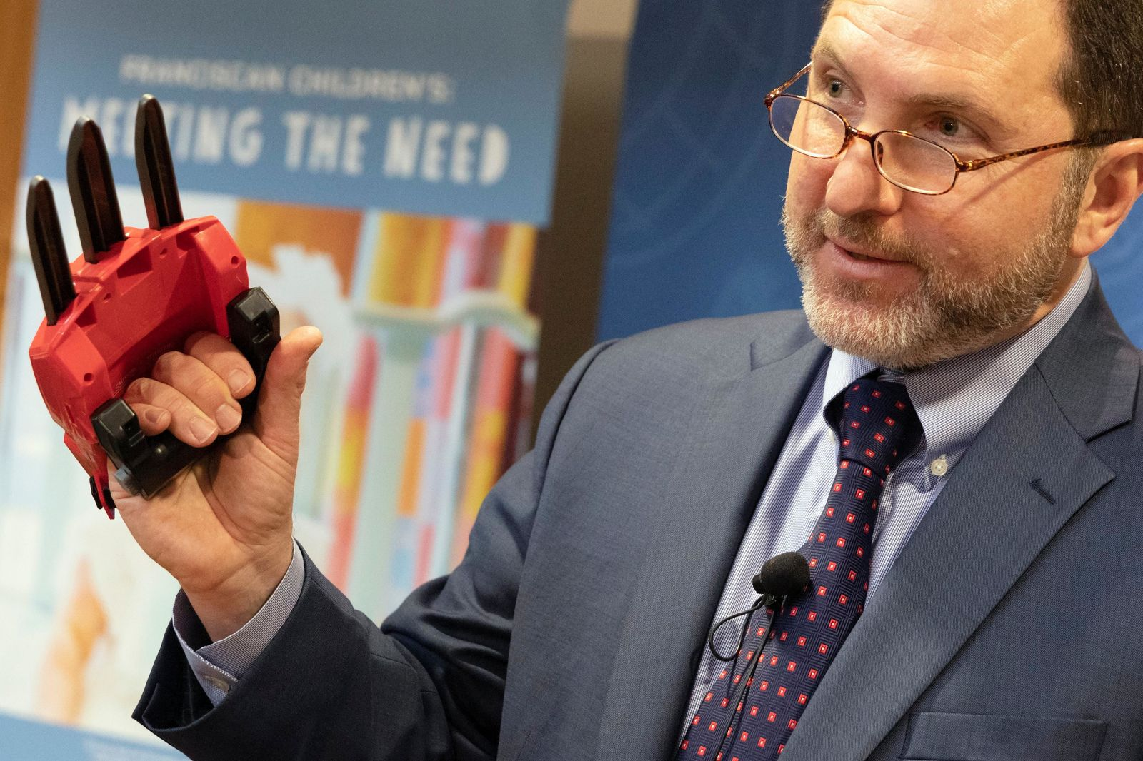 James Swarrtz, director of World Against Toys Causing Harm, talks about the dangers of the Power Rangers Electronic Cheetah Claw during a news conference in Boston, Tuesday, Nov. 19, 2019. (AP Photo/Michael Dwyer)