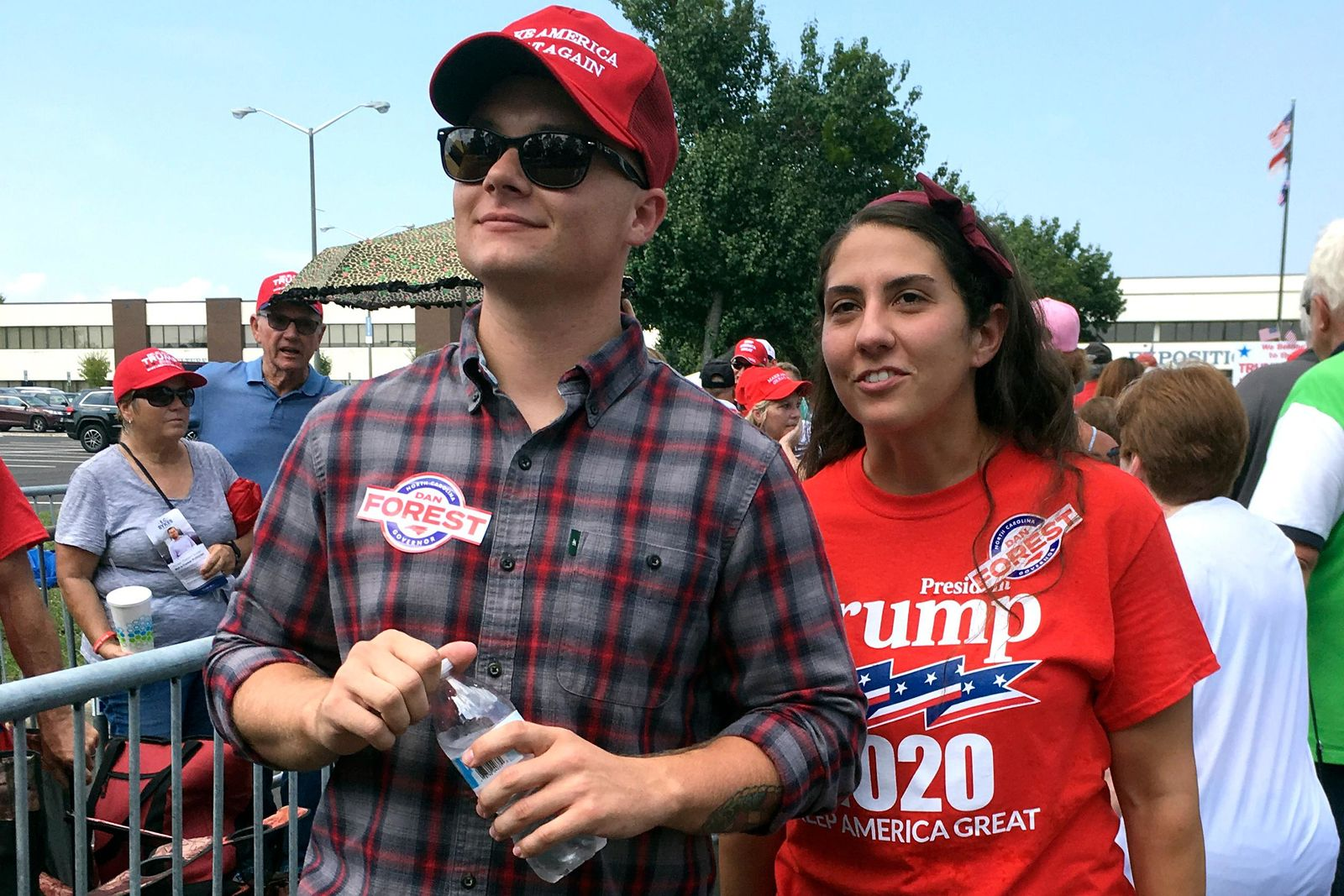 Ashley Arentz, 28, of Jacksonville, N.C., waits in line with friend Jonathan Ritter to enter a rally that President Donald Trump staged for Republican congressional candidate Dan Bishop in Fayetteville, N.C., Monday, Sept. 9, 2019. Arentz, a Marine, said she signed up to vote at the rally. (AP Photo/Alan Fram)