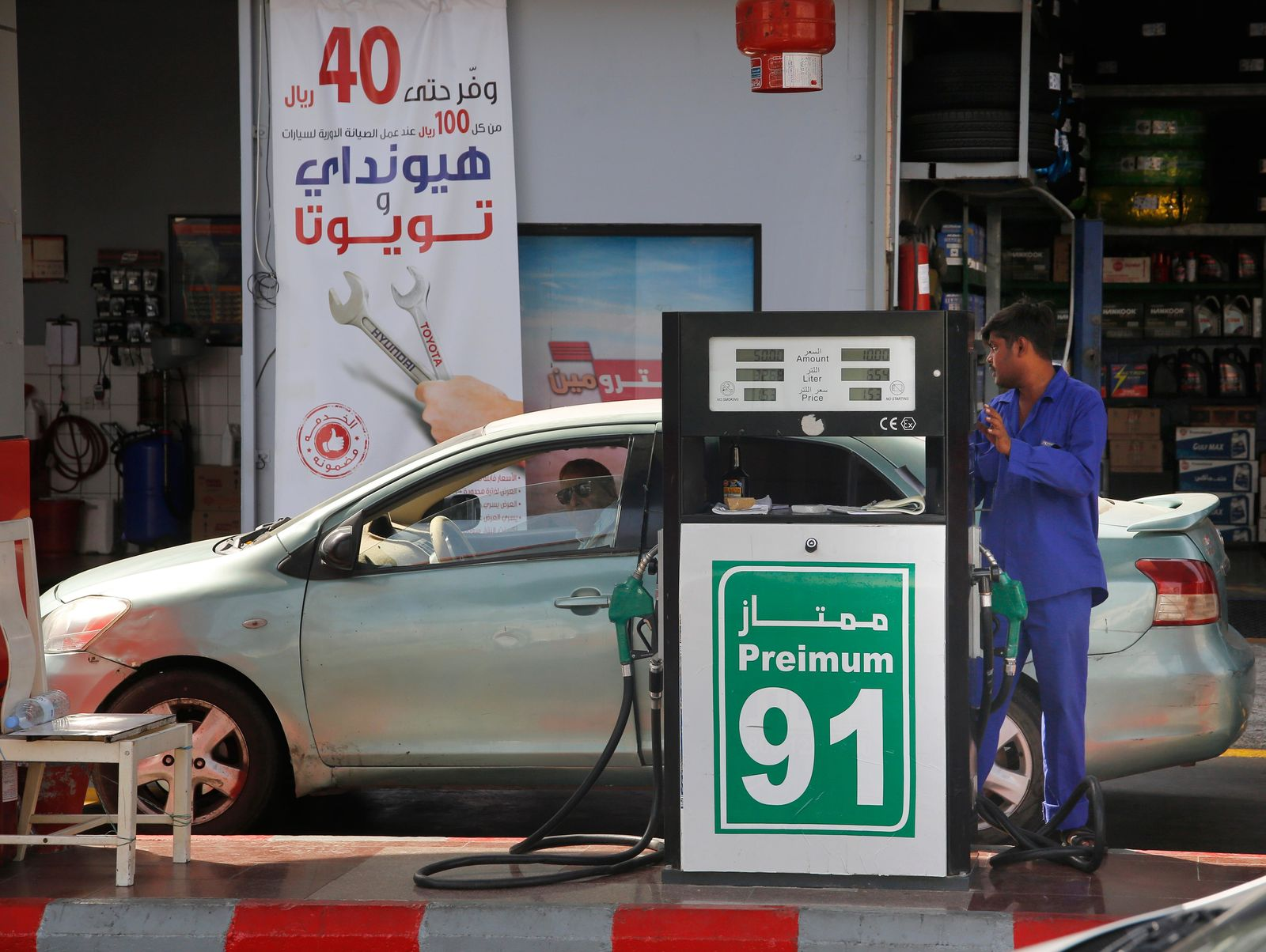 "A worker refuels a car at a gas station in Jiddah, Saudi Arabia, Monday, Sept. 16, 2019. Global energy prices spiked on Monday after a weekend attack on key oil facilities in Saudi Arabia caused the worst disruption to world supplies on record, an assault for which President Donald Trump warned that the U.S. was ""locked and loaded"" to respond. (AP Photo/Amr Nabil)"