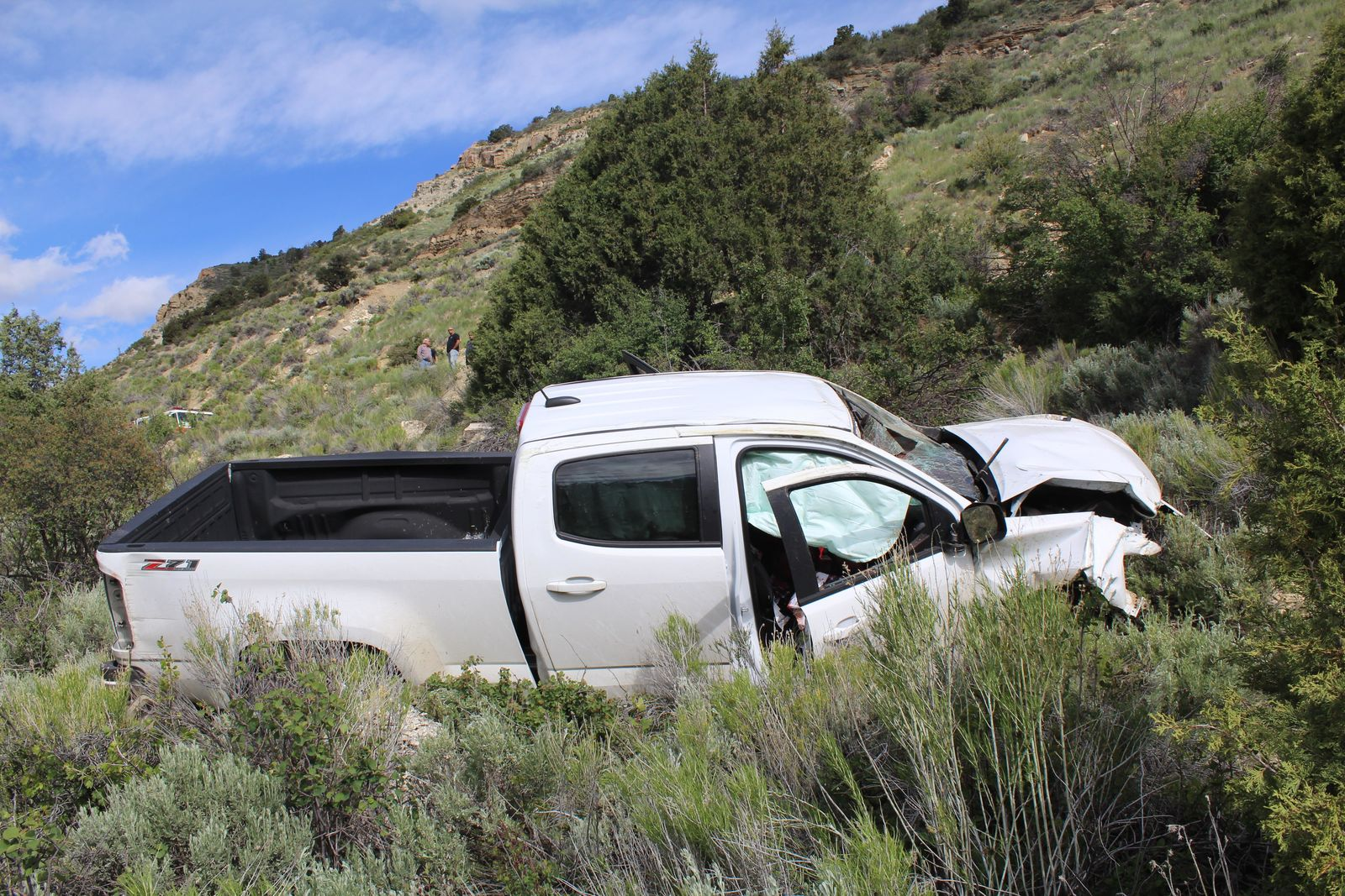 Man dies after driving vehicle off mountainside ledge in Duchesne County. (Photo: Utah Highway Patrol)