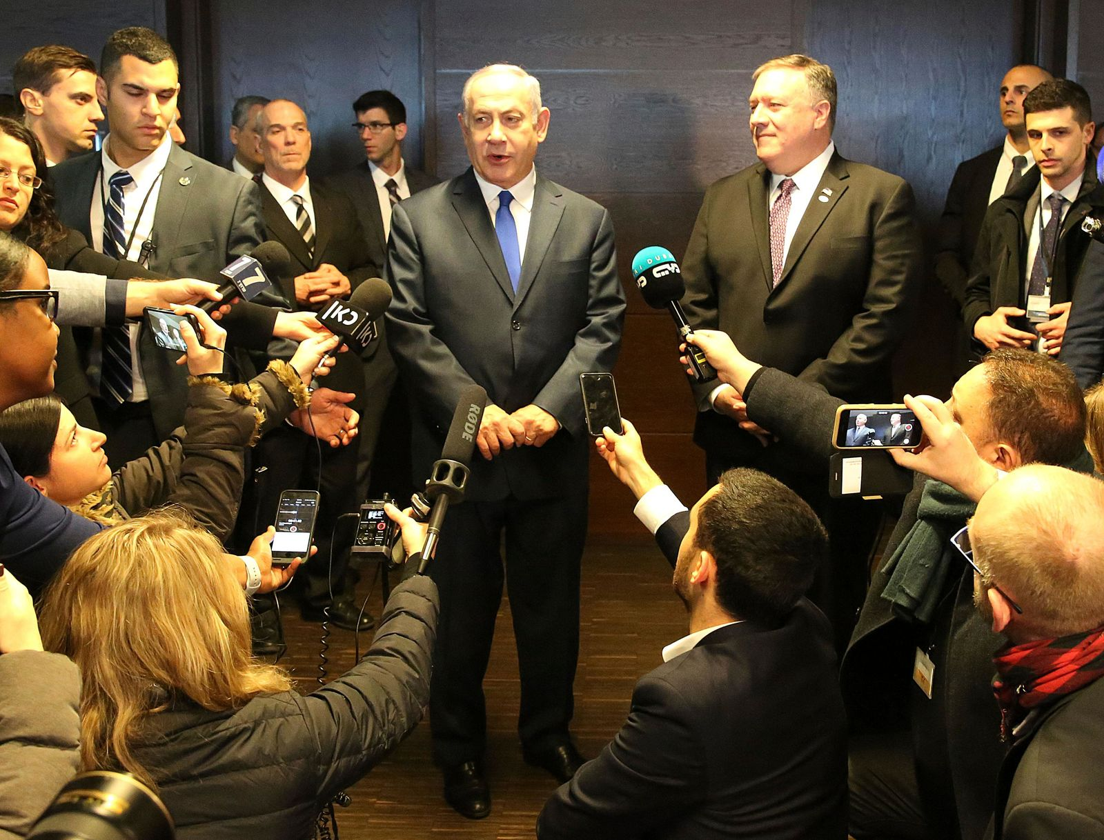 Israeli Prime Minister Benjamin Netanyahu, center left, and US Secretary of State Mike Pompeo, center right, talk to the press on the sidelines of a session at the conference on Peace and Security in the Middle East in Warsaw, Poland, Thursday, Feb. 14, 2019. (AP Photo/Czarek Sokolowski)