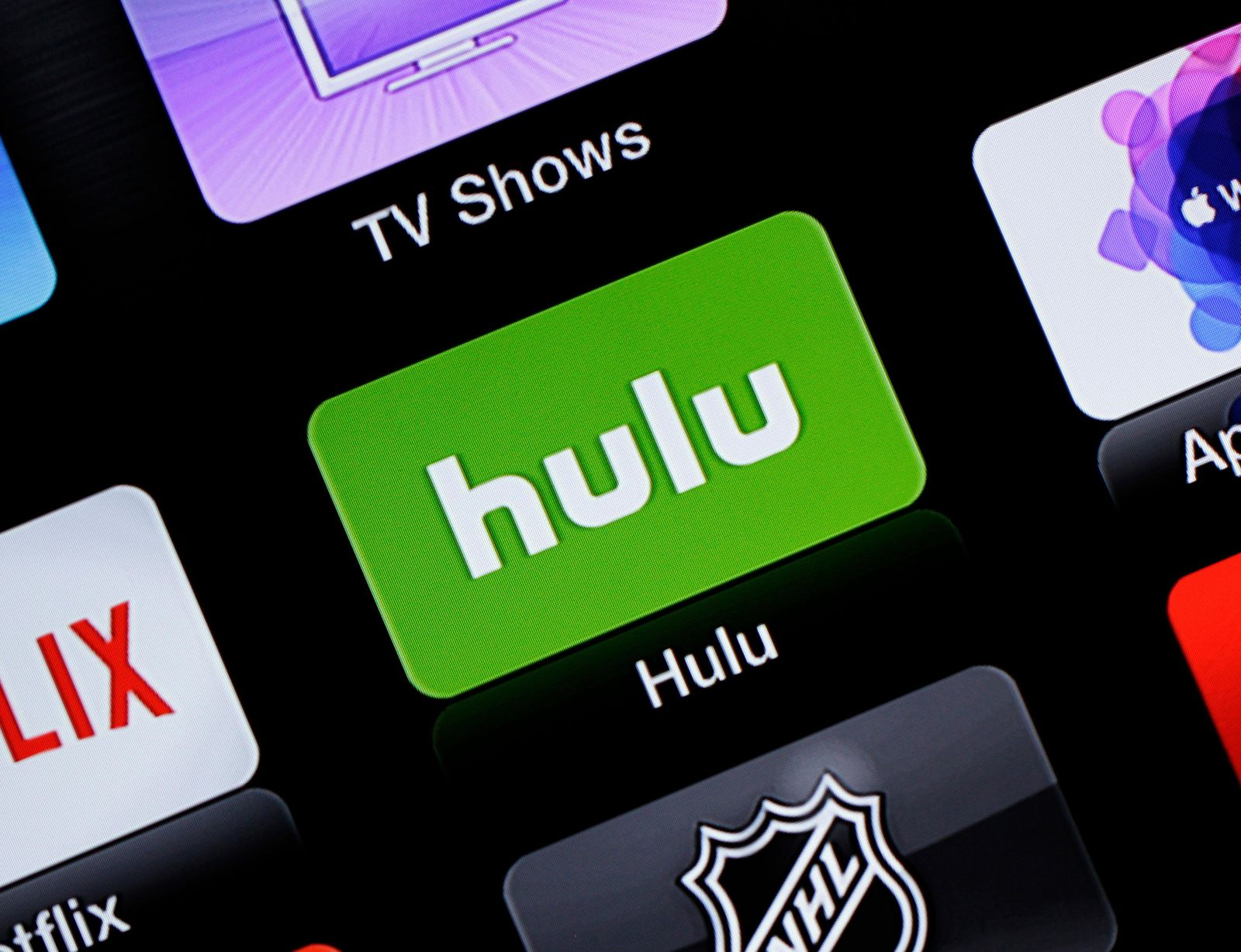 FILE- This June 24, 2015, file photo shows the Hulu Apple TV app icon in South Orange, N.J. Hulu's live-TV streaming service will cost $5 more per month, while its traditional video-on-demand service will be $2 cheaper. (AP Photo/Dan Goodman, File)