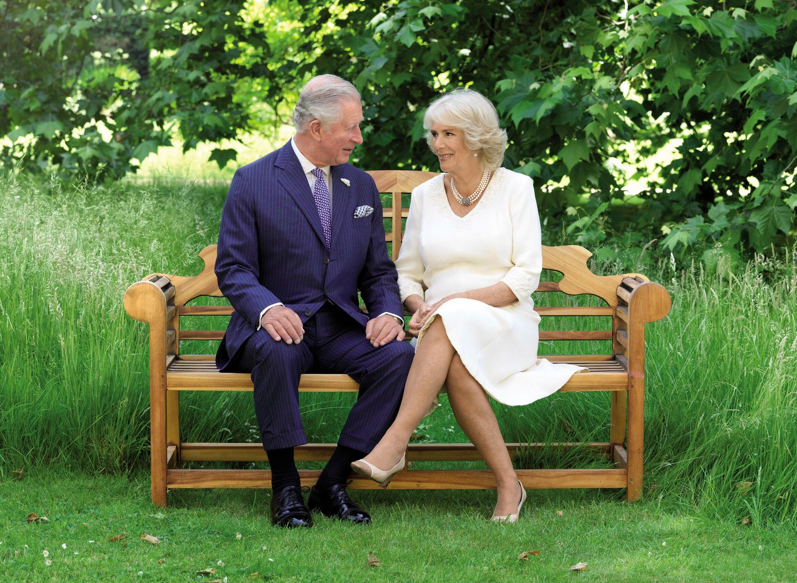 This photo released by Clarence House on Friday Dec. 14, 2018, shows the photo taken by Hugo Burnand of Britain's Prince Charles and Camilla, Duchess of Cornwall in the grounds of Clarence House, London. (Hugo Burnand/Clarence House via AP)