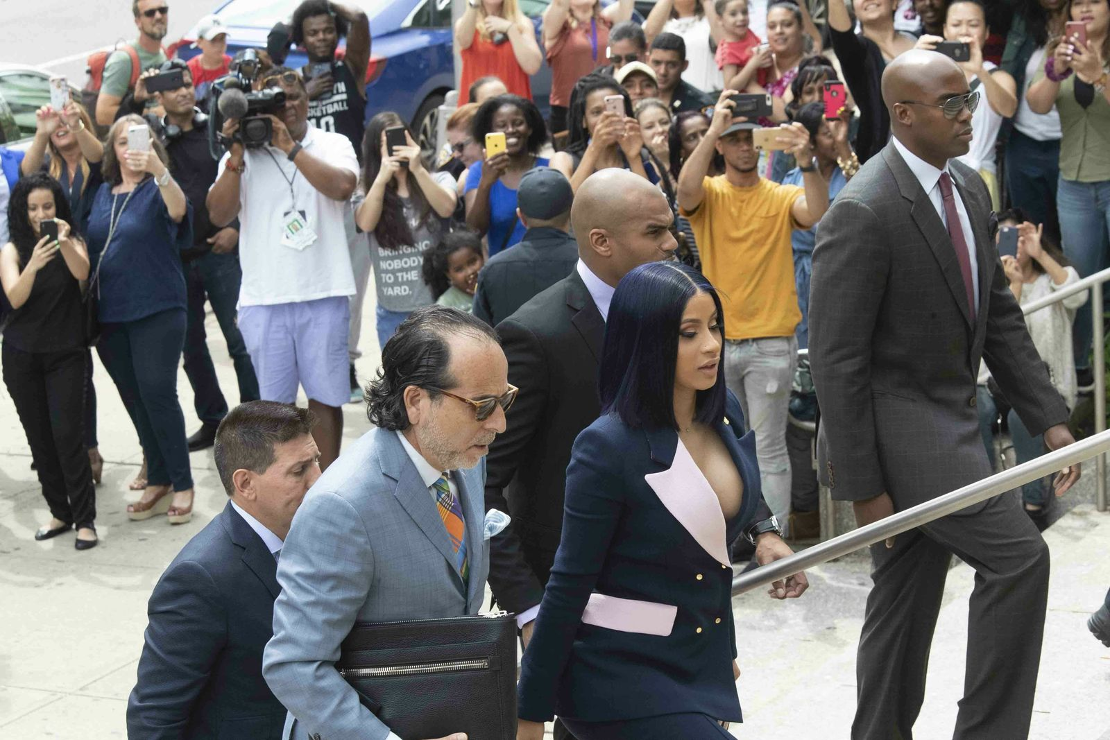 Fans take photos as Grammy-winning rapper Cardi B arrives for a hearing at Queens County Criminal Court, Tuesday, June 25, 2019, in New York. (AP Photo/Mary Altaffer)