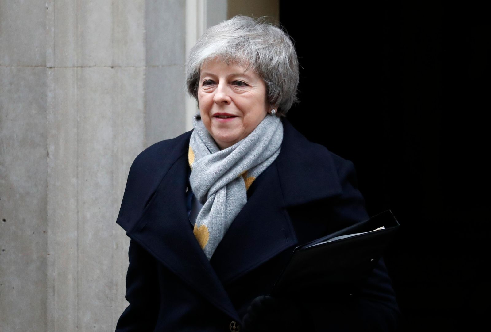 Britain's Prime Minister Theresa May leaves a cabinet meeting at Downing Street in London, Tuesday, Jan. 15. (AP Photo/Frank Augstein)