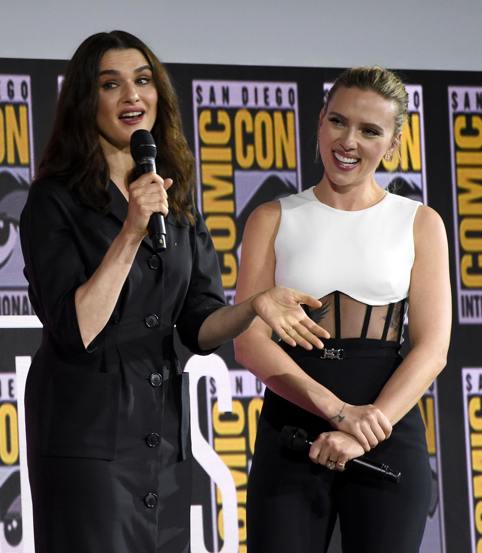 "Rachel Weisz, left, and Scarlett Johansson participate during the ""Black Widow"" portion of the Marvel Studios panel on day three of Comic-Con International on Saturday, July 20, 2019, in San Diego. (Photo by Chris Pizzello/Invision/AP)"