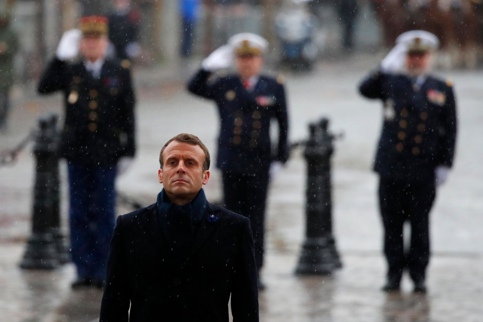 French President Emmanuel Macron stand at attention at the Arc de Triomphe during commemorations marking the 101st anniversary of the 1918 armistice, ending World War I, Monday Nov. 11, 2019 in Paris (AP Photo/Francois Mori, Pool)