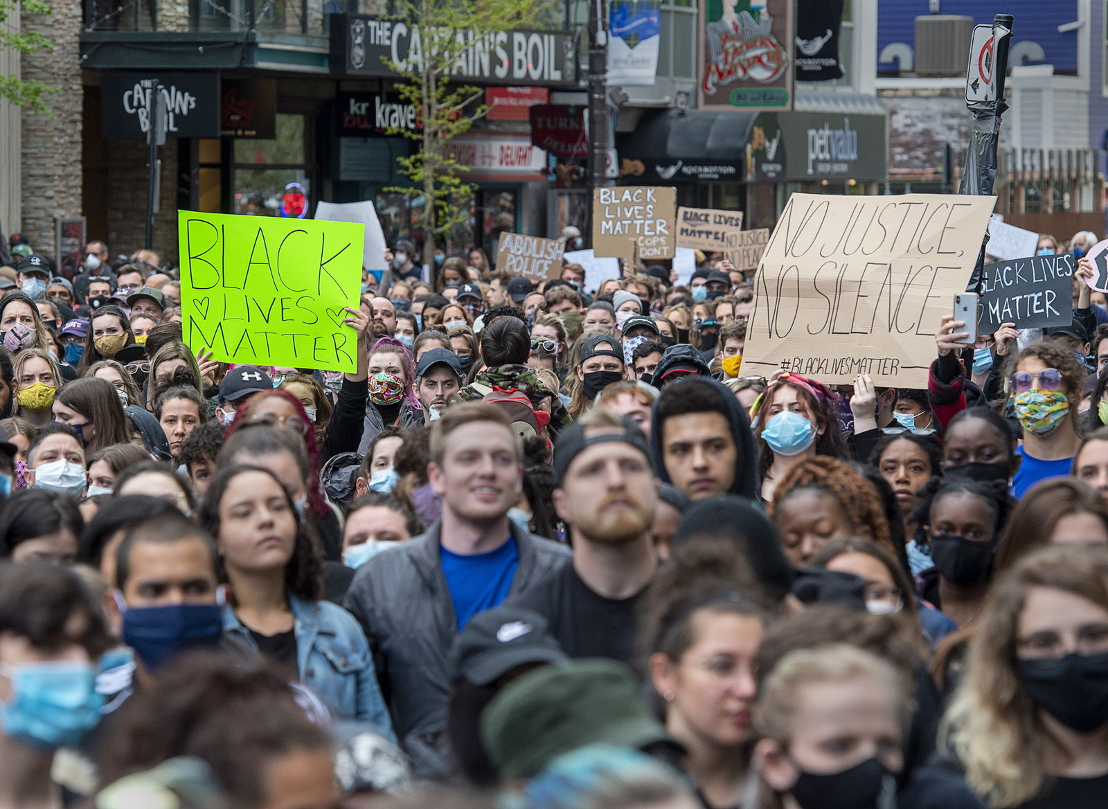 Protesters take to the streets to demonstrate against police action in the death of George Floyd and others in Halifax, Nova Scotia, on Monday, June 1, 2020. (Andrew Vaughan/The Canadian Press via AP)