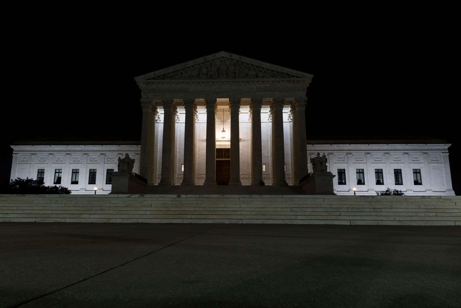 The Supreme Court is seen in Washington, late Tuesday, July 16, 2019. Former U.S. Supreme Court Justice John Paul Stevens died Tuesday in Fort Lauderdale, Fla., after suffering a stroke Monday. He was 99. (AP Photo/Carolyn Kaster)