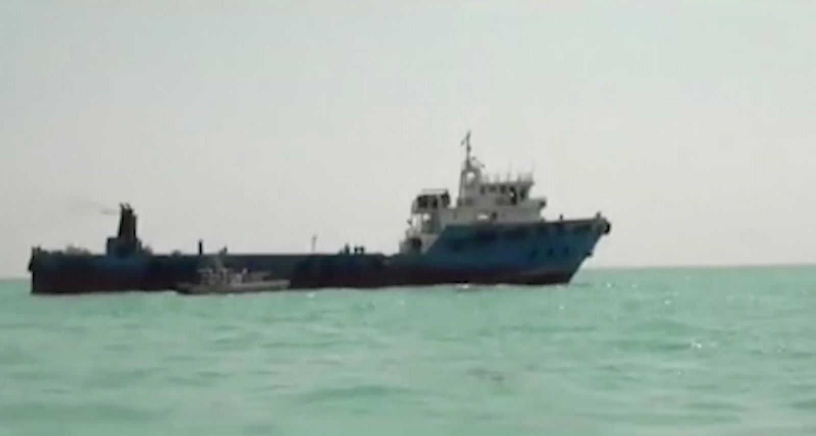 This undated image made from a video provided by the IRGC/IRIB shows a ship in the Persian Gulf. Iranian forces seized the ship, which it suspected of carrying smuggled fuel, state media reported Sunday, Aug. 4, 2019. (IRGC/IRIB via AP)