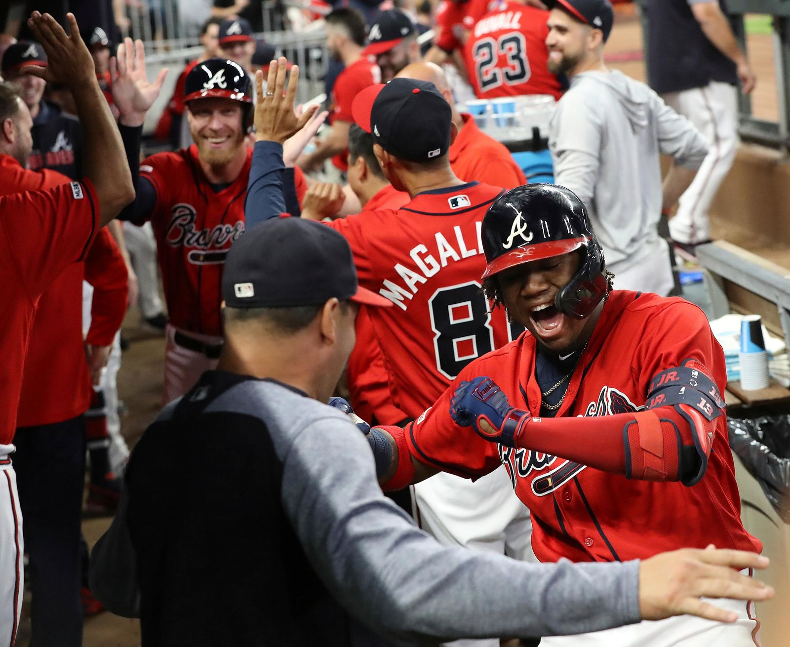Atlanta Braves Ronald Acuna Jr., right, reacts after hitting a two-RBI home run to score Mike Foltynewicz, left, against the San Francisco Giants during the fifth inning in a baseball game on Friday, Sept. 20, 2019, in Atlanta. (Curtis Compton/Atlanta Journal-Constitution via AP)