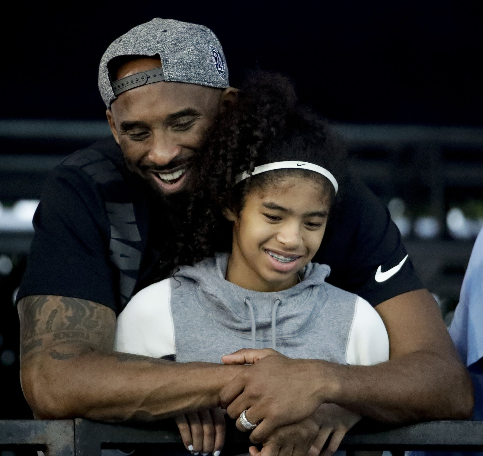 FILE - In this July 26, 2018, file photo former Los Angeles Laker Kobe Bryant and his daughter Gianna watch during the U.S. national championships swimming meet in Irvine, Calif. (AP Photo/Chris Carlson,File)