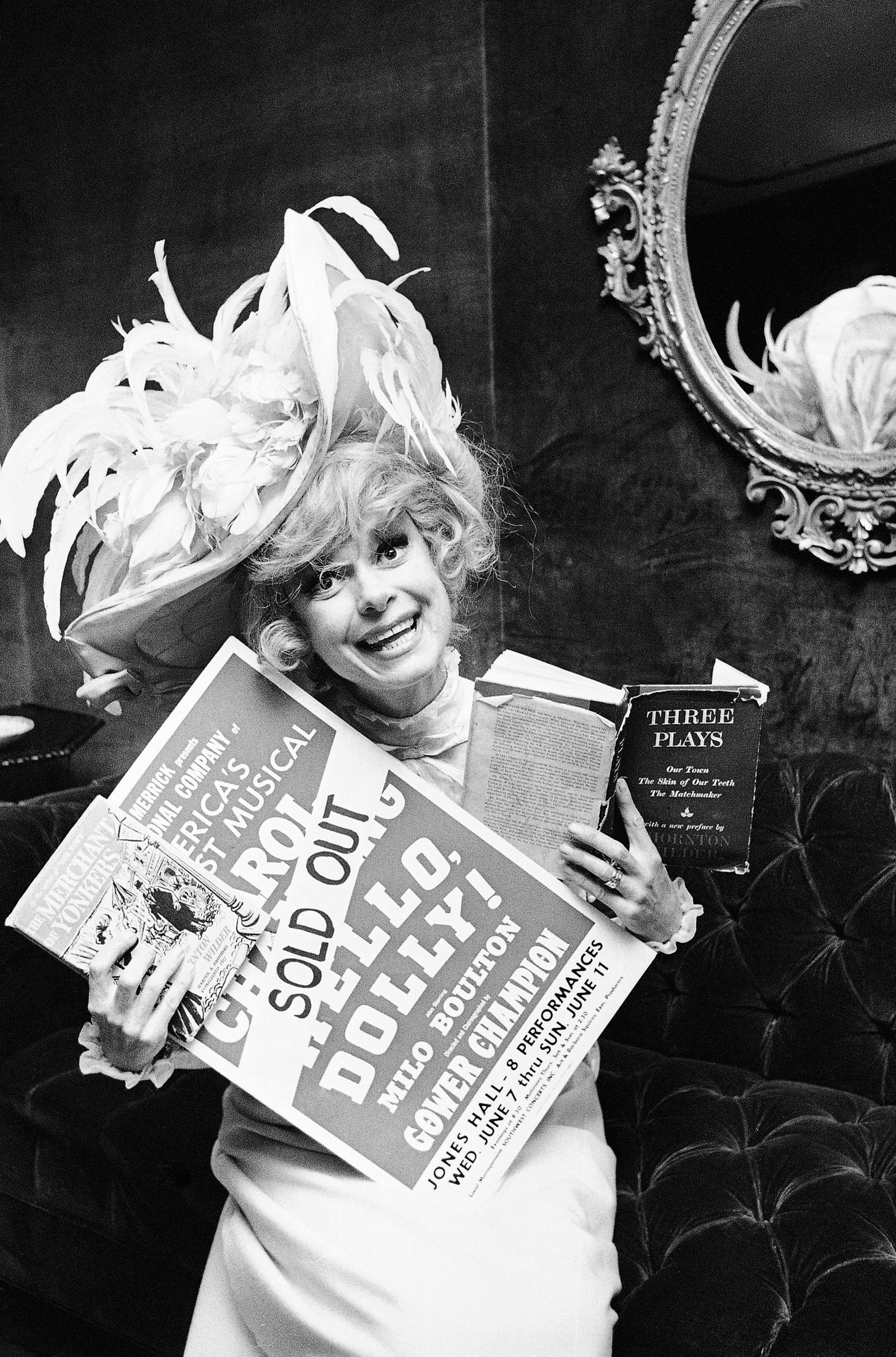 "FILE - In this June 11, 1967 file photo, Carol Channing holds a sold out advertisement poster of ""Hello, Dolly""  in Houston. Channing, whose career spanned decades on Broadway and on television has died at age 97. Publicist B. Harlan Boll says Channing died of natural causes early Tuesday, Jan. 15, 2019 in Rancho Mirage, Calif. (AP Photo/Ed Kolenovsky, File)"