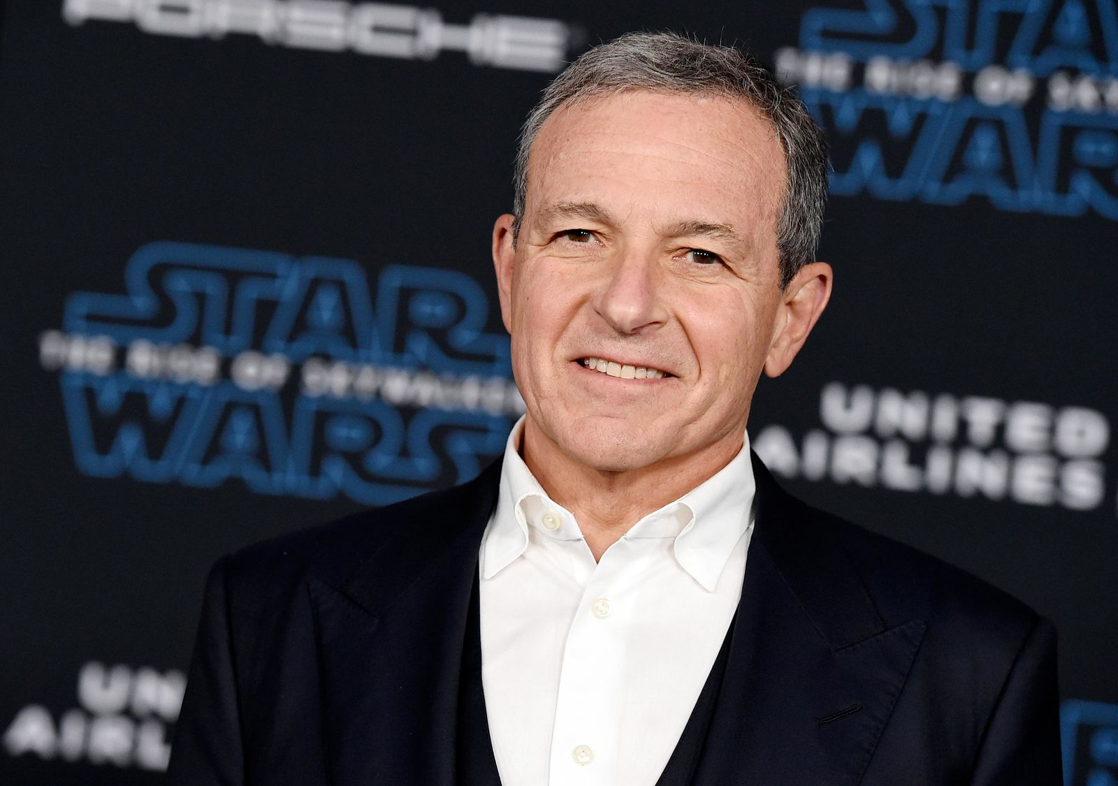 "FILE - In this Dec. 16, 2019, file photo, Disney CEO Robert Iger arrives at the world premiere of ""Star Wars: The Rise of Skywalker"", in Los Angeles  The Walt Disney Co. has named Bob Chapek CEO, replacing Bob Iger, effective immediately, the company announced Tuesday, Feb. 25, 2020.  (Jordan Strauss/Invision/AP, FIle)"
