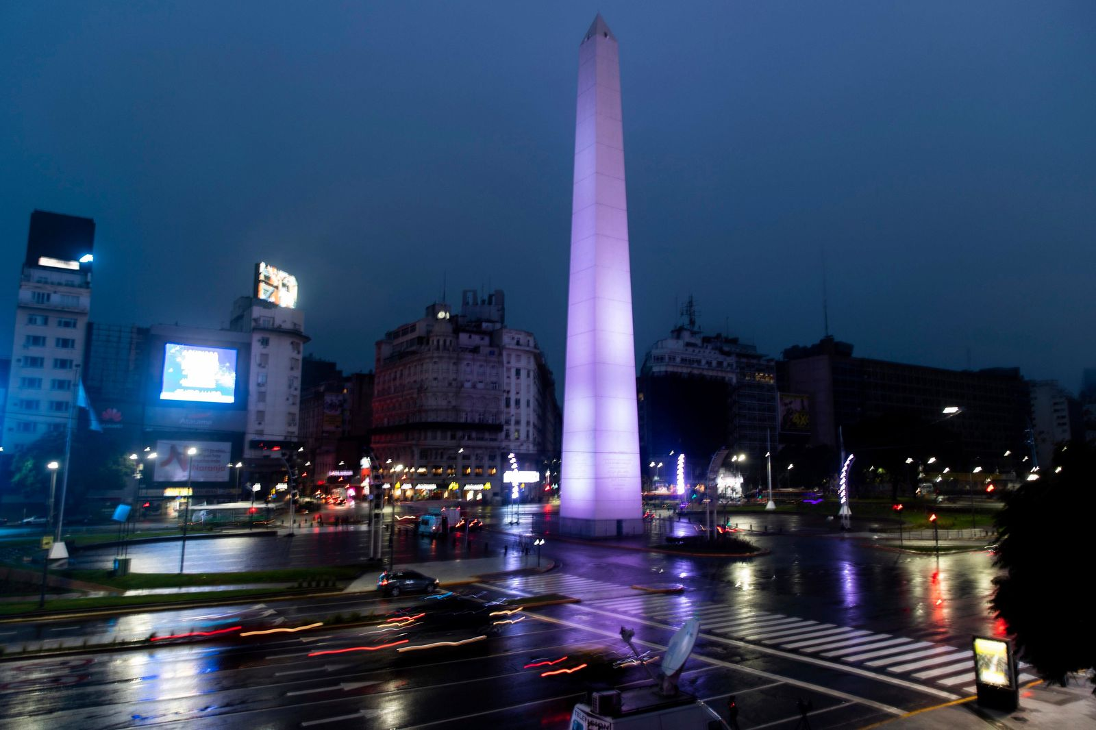 Cars drive on the 9 de Julio Ave, past the illuminated Obelisk monument in Buenos Aires, Argentina, early Monday morning, June 17, 2019. As lights turned back on across Argentina, Uruguay and Paraguay after a massive blackout that hit tens of millions people, authorities were still largely in the dark about what caused the collapse of the interconnected grid and were tallying the damage from the unforeseen disaster. (AP Photo/Tomas F. Cuesta)