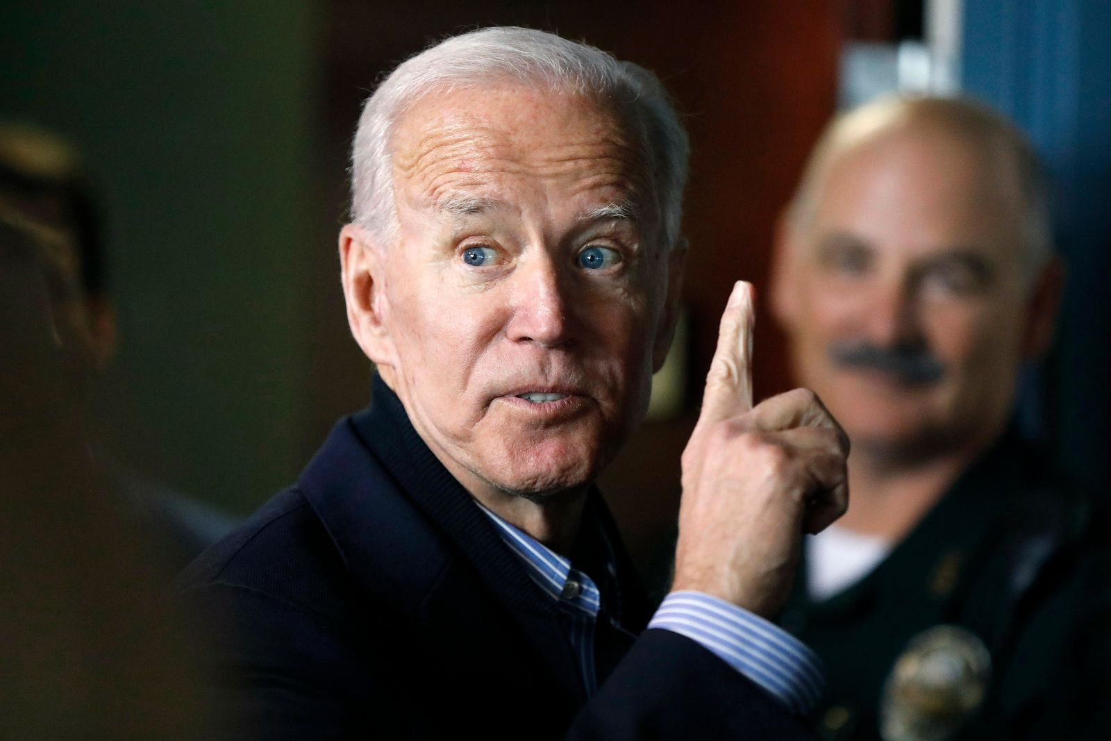 In this May 13, 2019, photo, former vice president and Democratic presidential candidate Joe Biden interacts with a supporter during a campaign stop at the Community Oven restaurant in Hampton, N.H. . (AP Photo/Michael Dwyer, File)