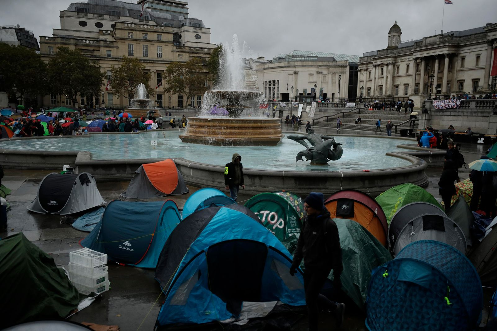 Extinction Rebellion climate change protester tents stand setup in Trafalgar Square, London, Friday, Oct. 11, 2019. Some hundreds of climate change activists are in London during a fifth day of protests by the Extinction Rebellion movement to demand more urgent actions to counter global warming. (AP Photo/Matt Dunham)
