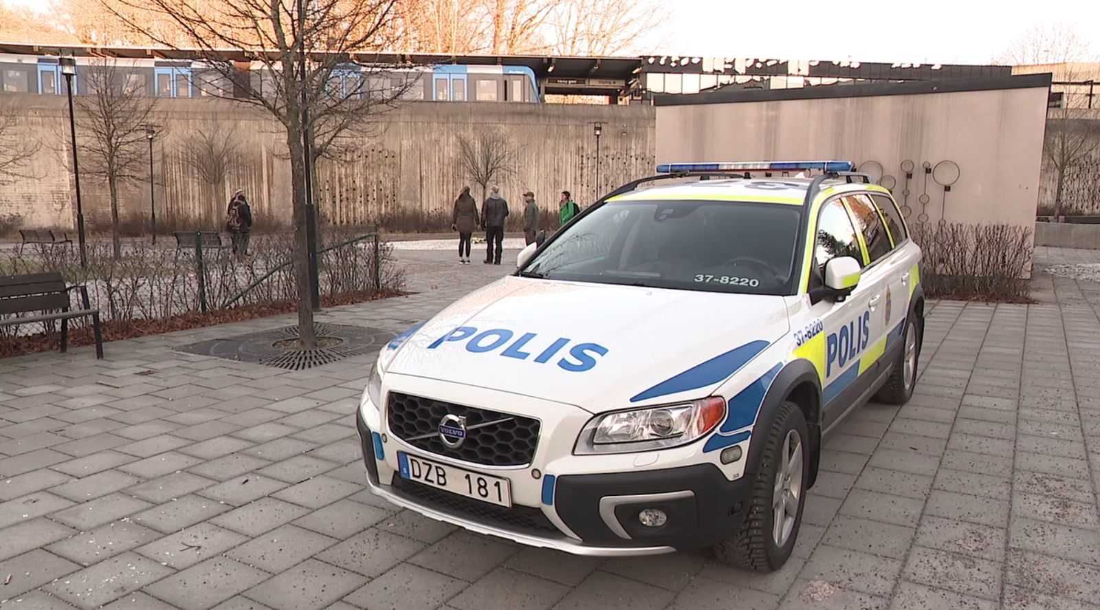 Police stationed outside Vårby gård metro station where a man died after picking up an explosive device on a Sunday afternoon . (Sinclair Broadcast Group)<p></p>