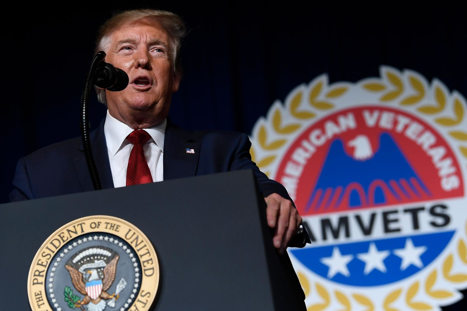 President Donald Trump speaks at the American Veterans (AMVETS) 75th National Convention in Louisville, Ky., Wednesday, Aug. 21, 2019. (AP Photo/Susan Walsh)