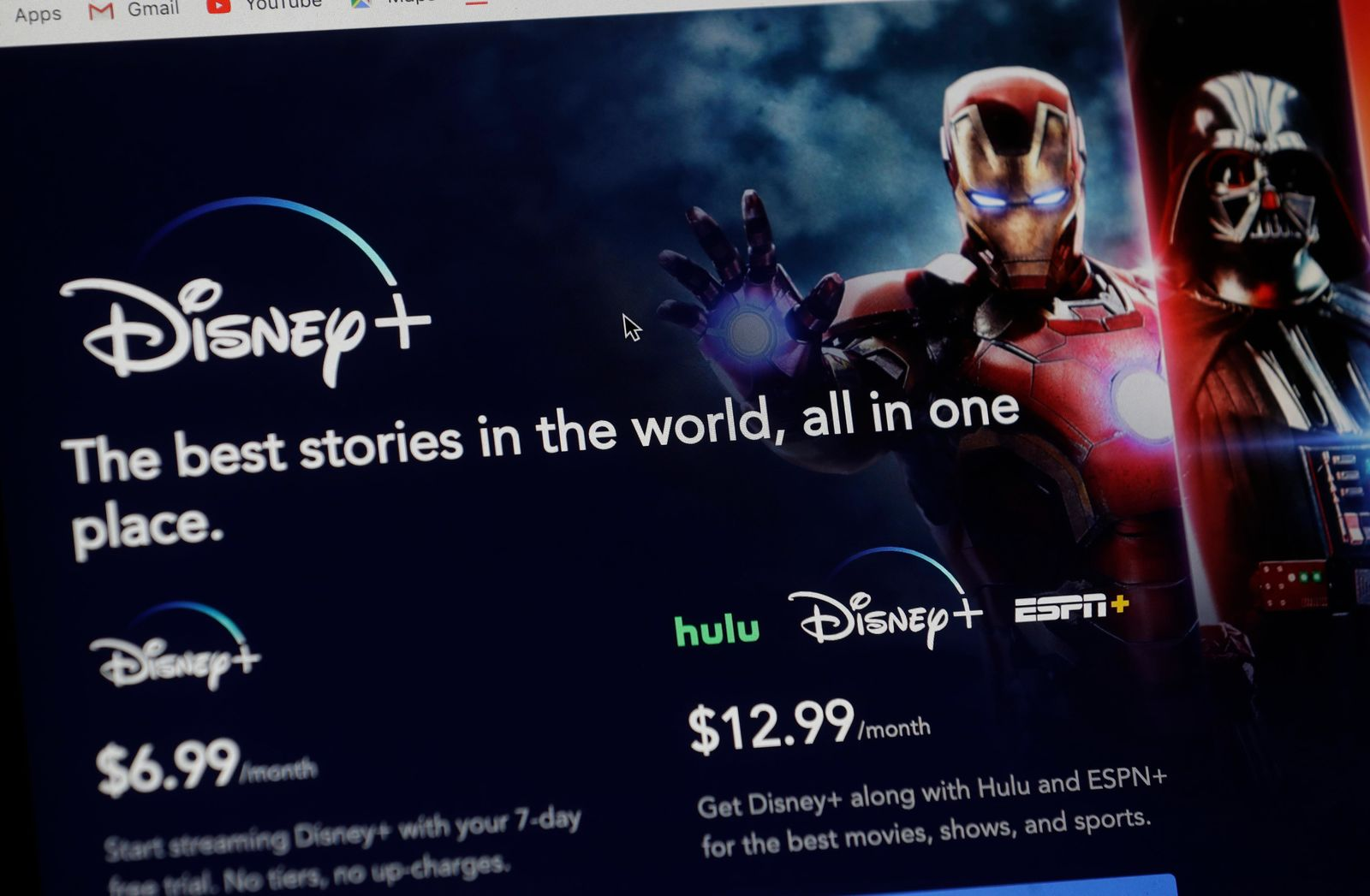 An introductory page on the Disney Plus website is displayed on a computer screen in Walpole, Mass., Wednesday, Nov. 13, 2019. Disney Plus says it hit more than 10 million sign-ups on its first day of launch, far exceeding expectations. (AP Photo/Steven Senne)
